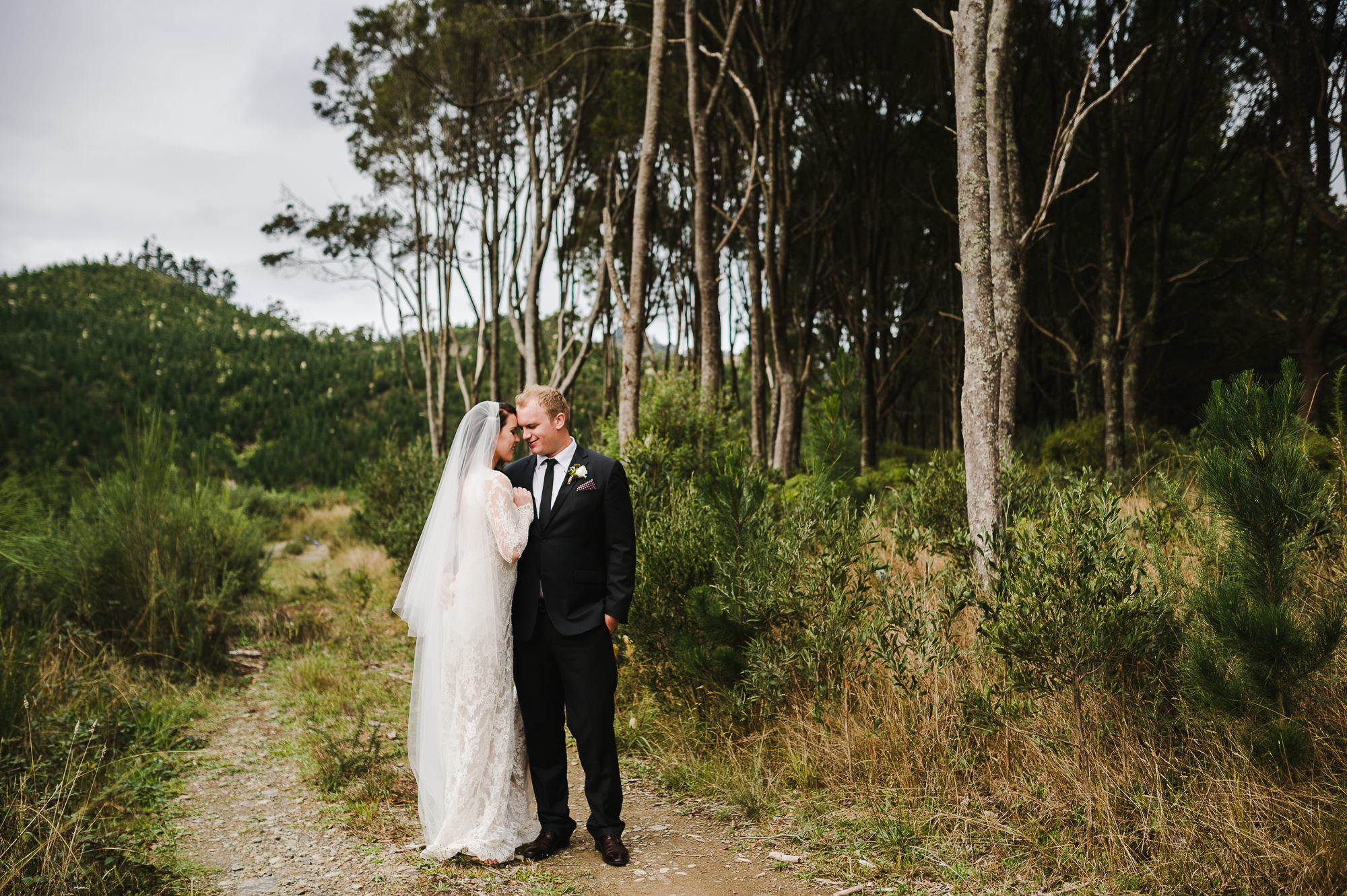 wedding couple in forest plantation.jpg