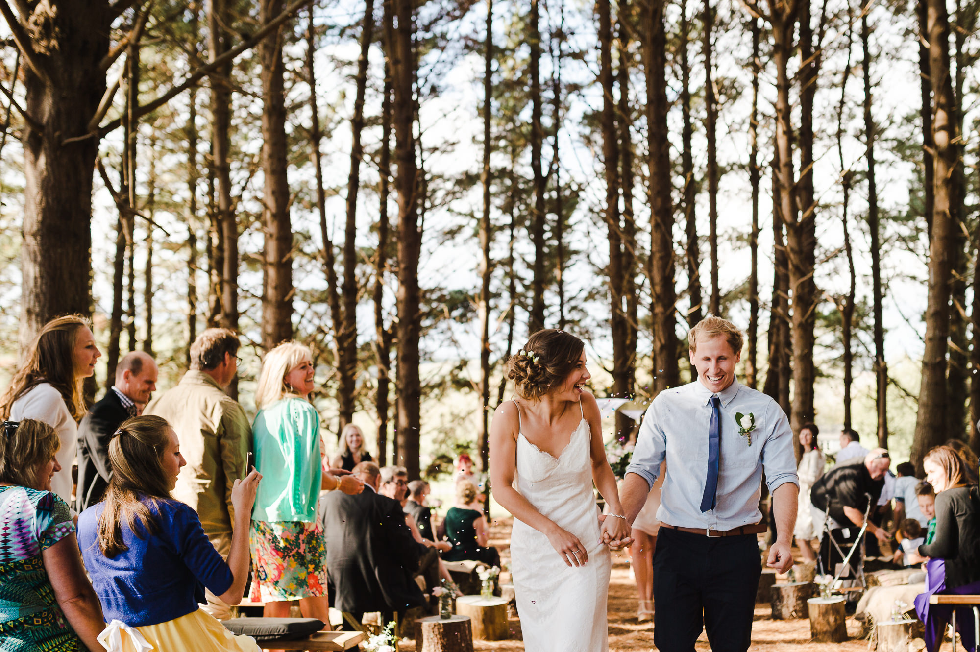walking down aisle in forest married.jpg