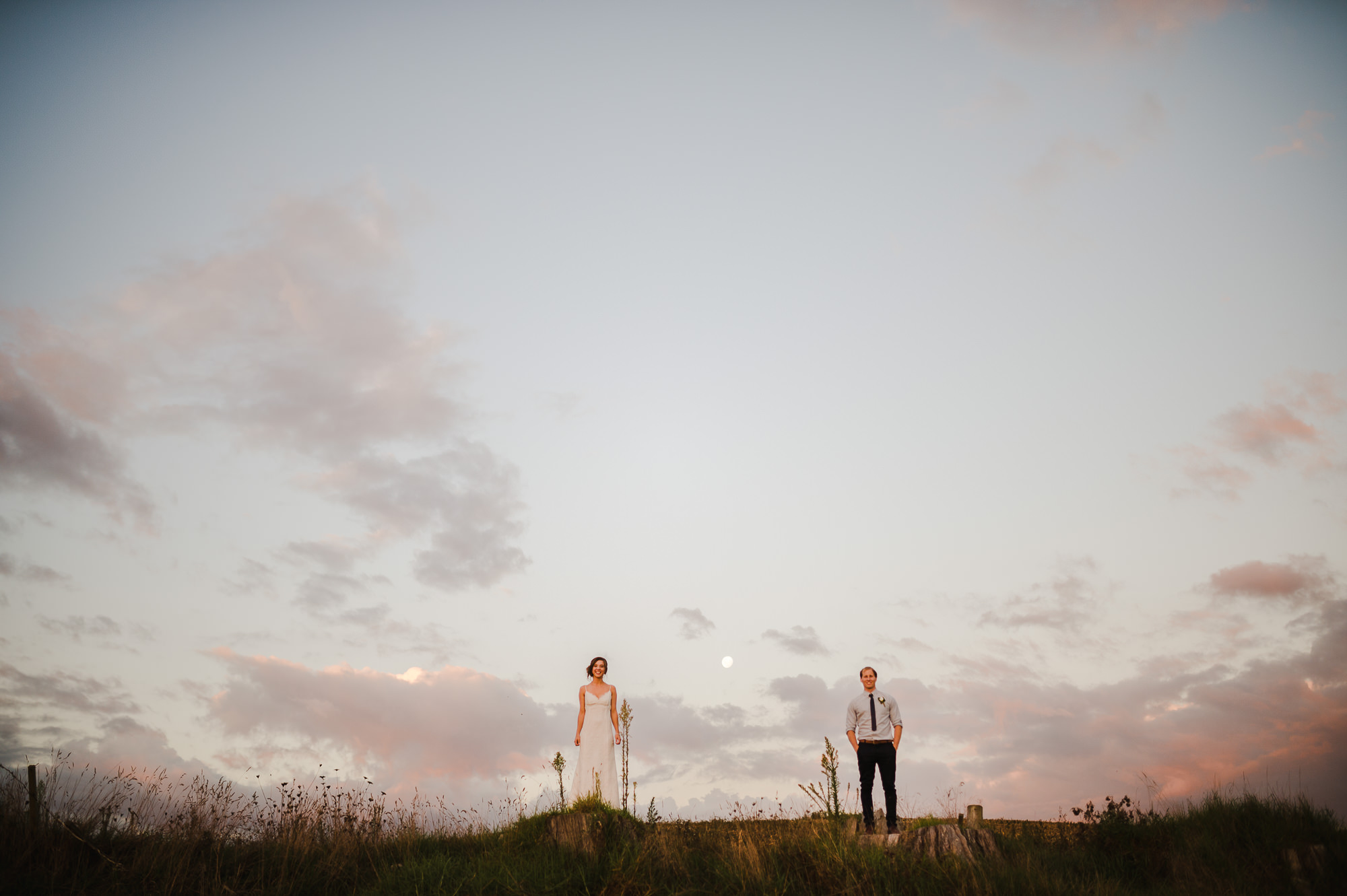 bride and groom at dusk with moon.jpg