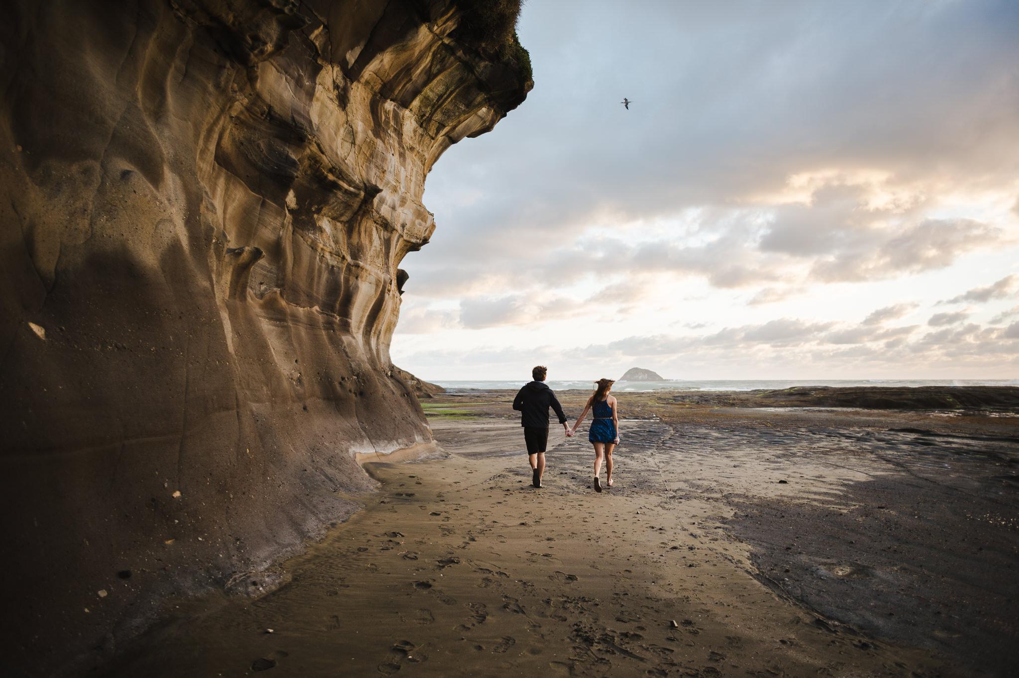 10 couple exploring west coast beach auckland in love.JPG
