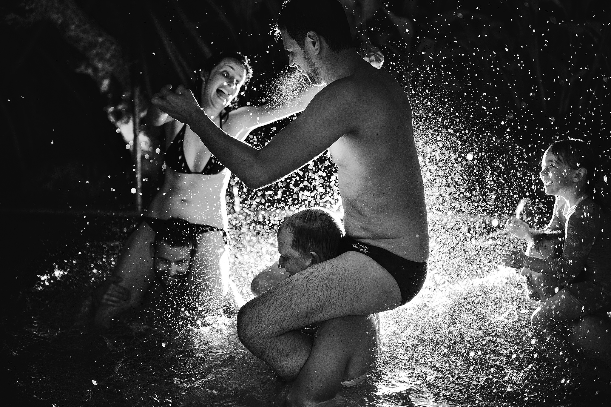 11 Documentary Moment Wedding in pool splashing epic backlit shot.JPG