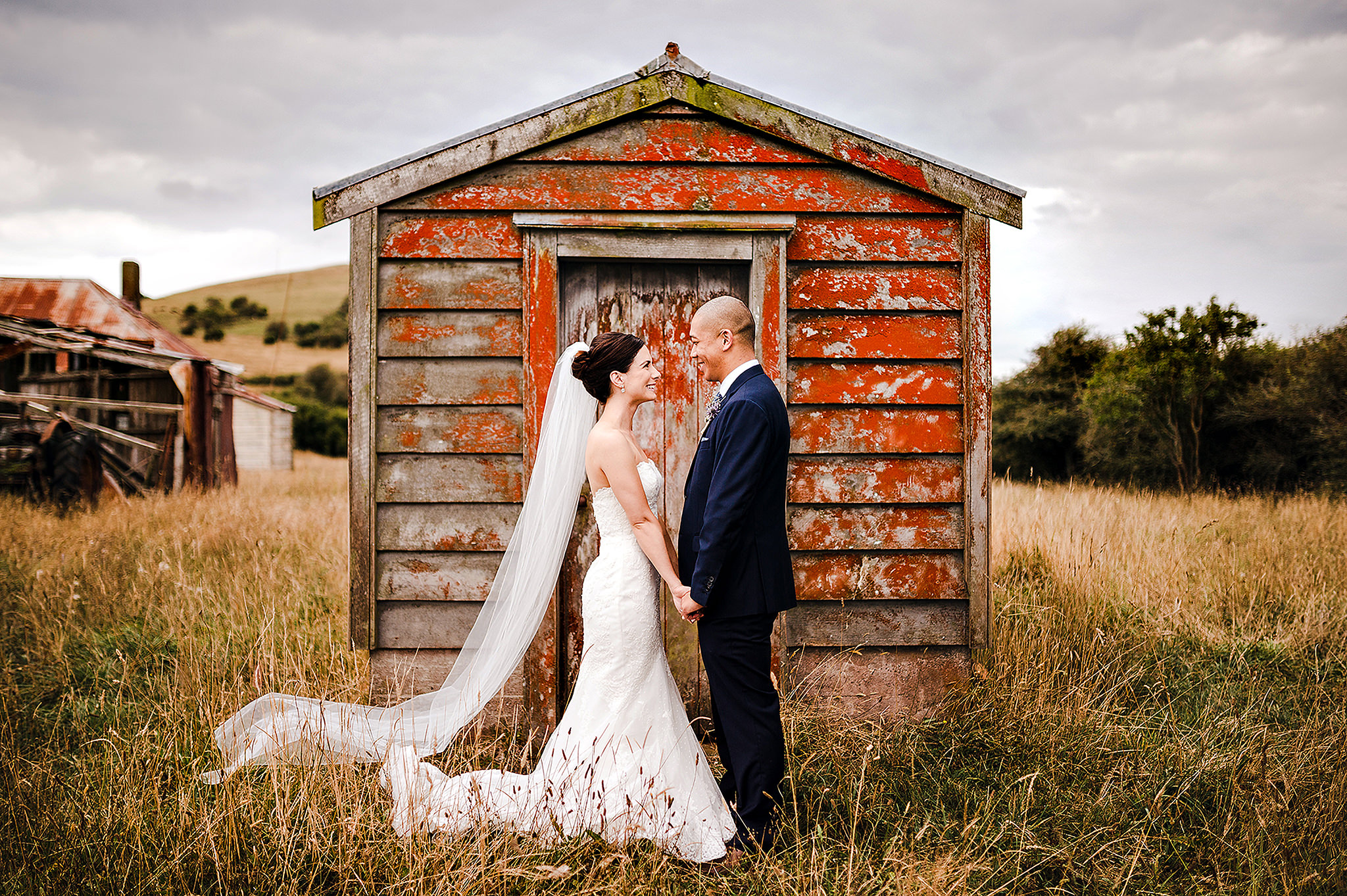 61 wedding couple in front of red barn auckland.JPG