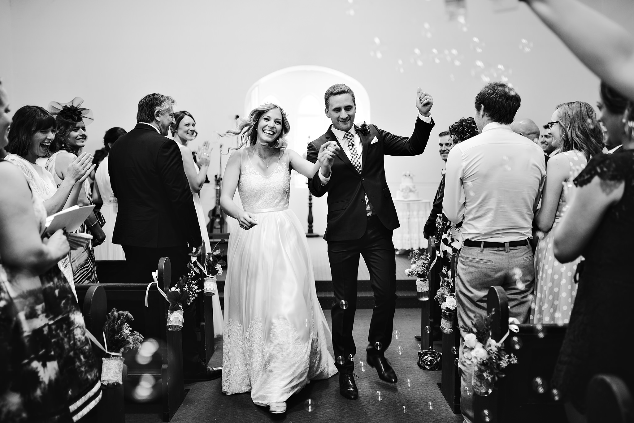63 church wedding bride and groom walking down aisle with bubbles.JPG