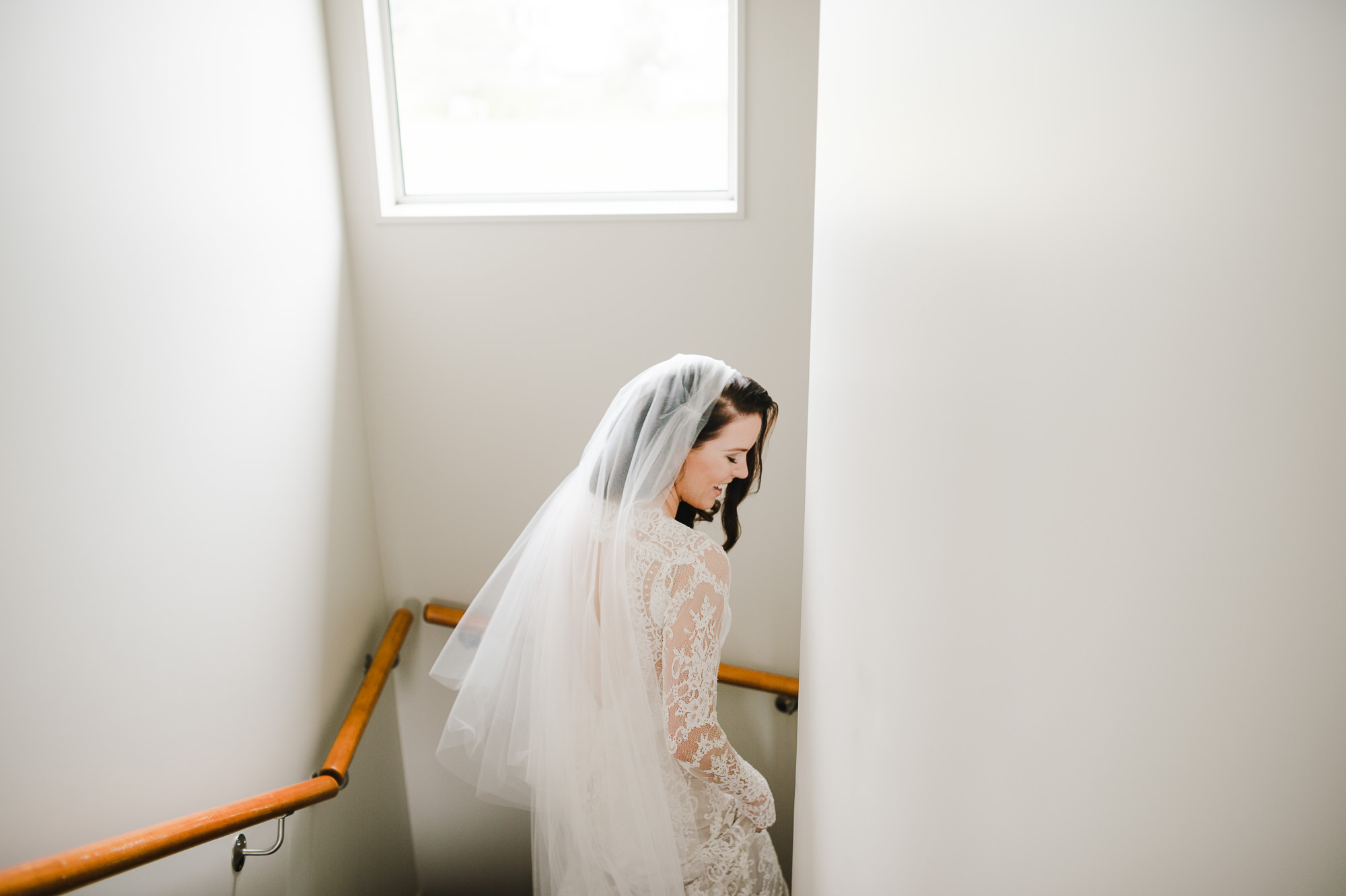 64A bride walking own stairway.JPG