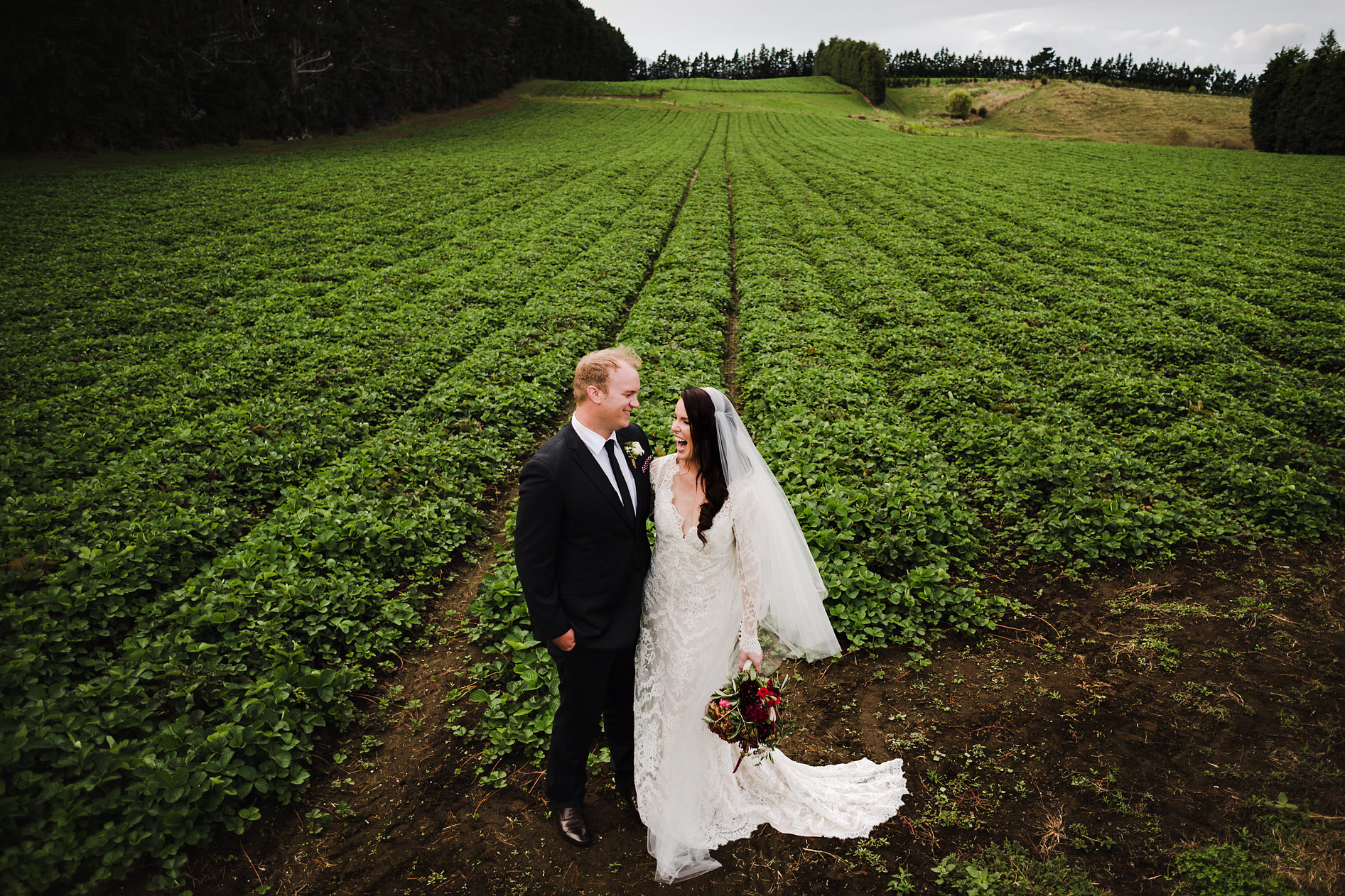 67 bride and groom in waihi field.JPG