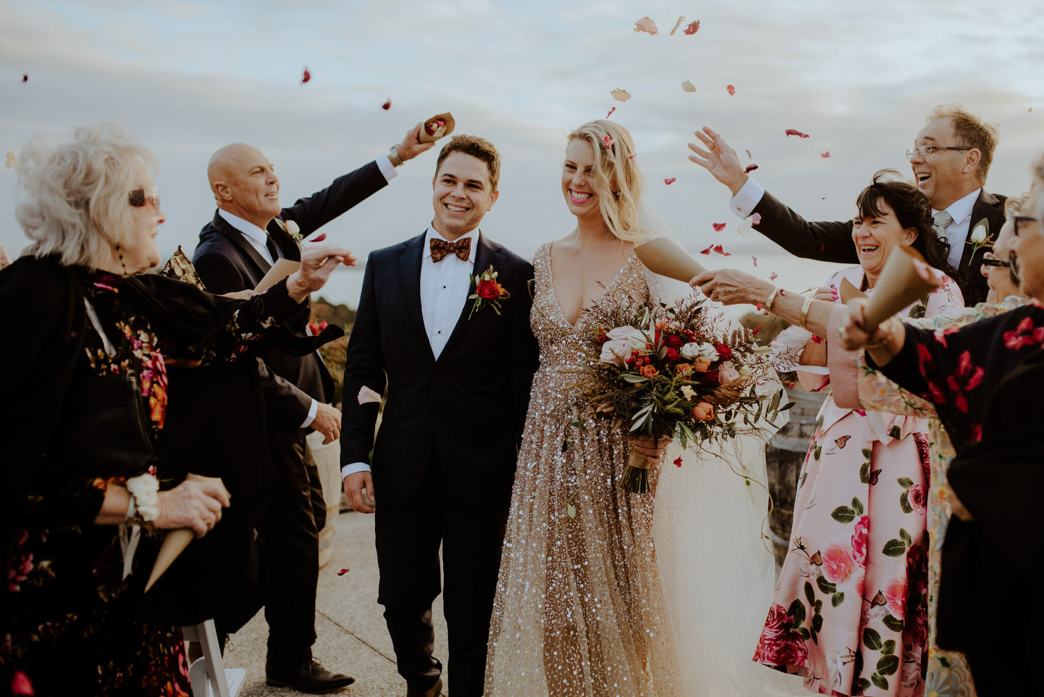 Mudbrick rose petal confetti ceremony at sunset