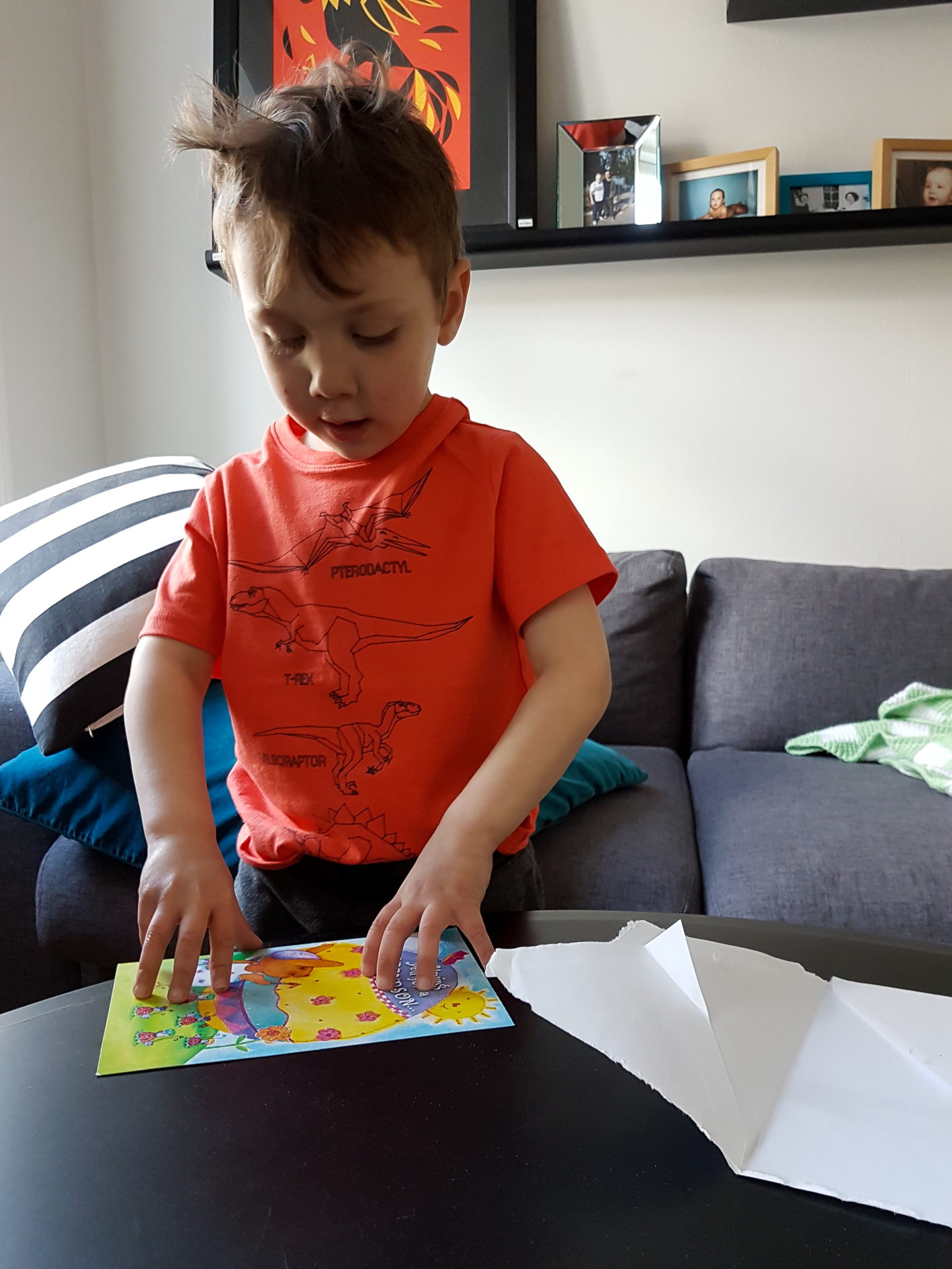 Opening his Easter card from Meema.