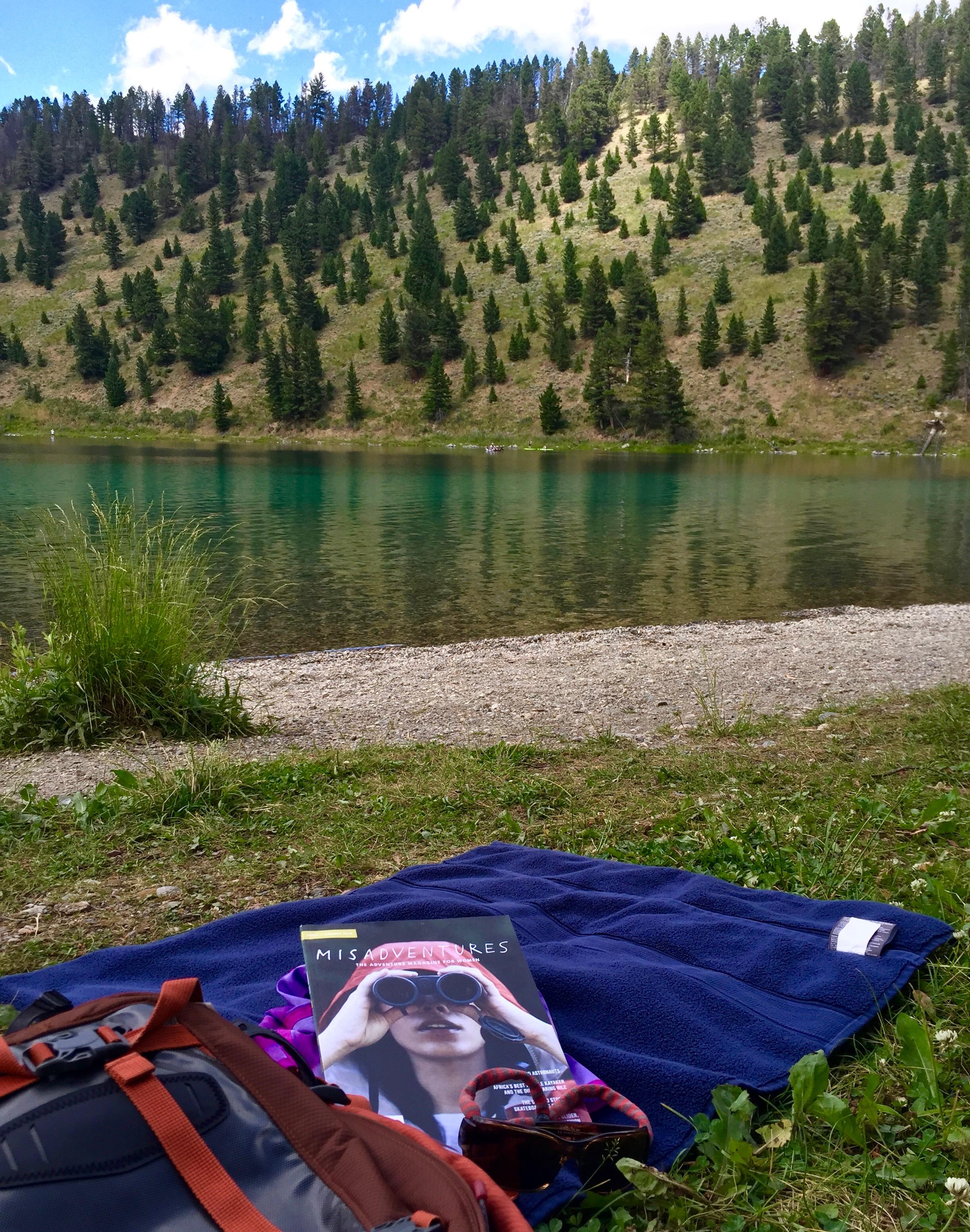Enjoying my reading at stunning Wade Lake in Montana!