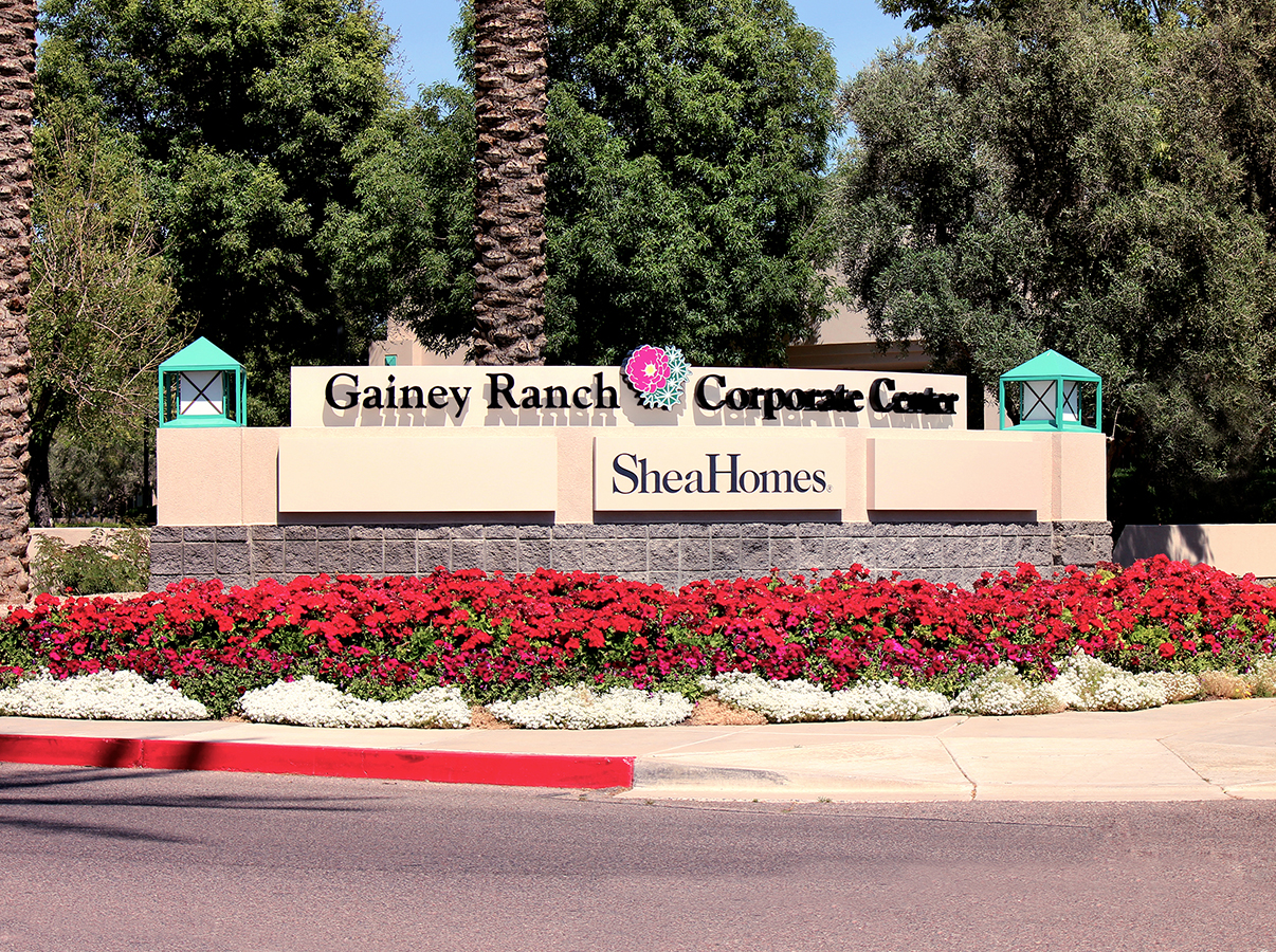 The existing wall was retrofitted to add illuminated tenant panels and the Gainey Ranch Corporate Center logo.