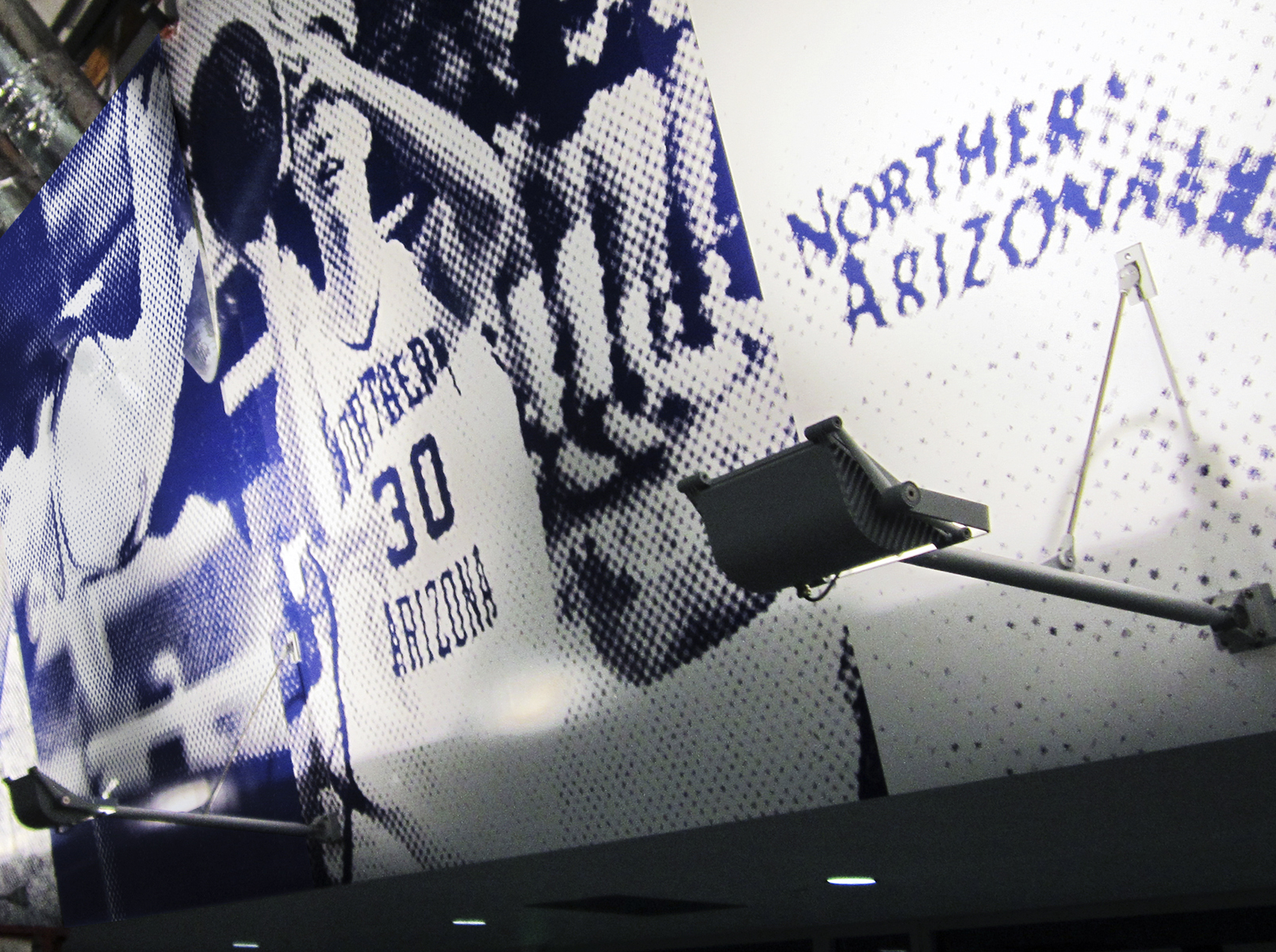 An externally lit wallpaper graphic wraps the entire Skydome concourse.