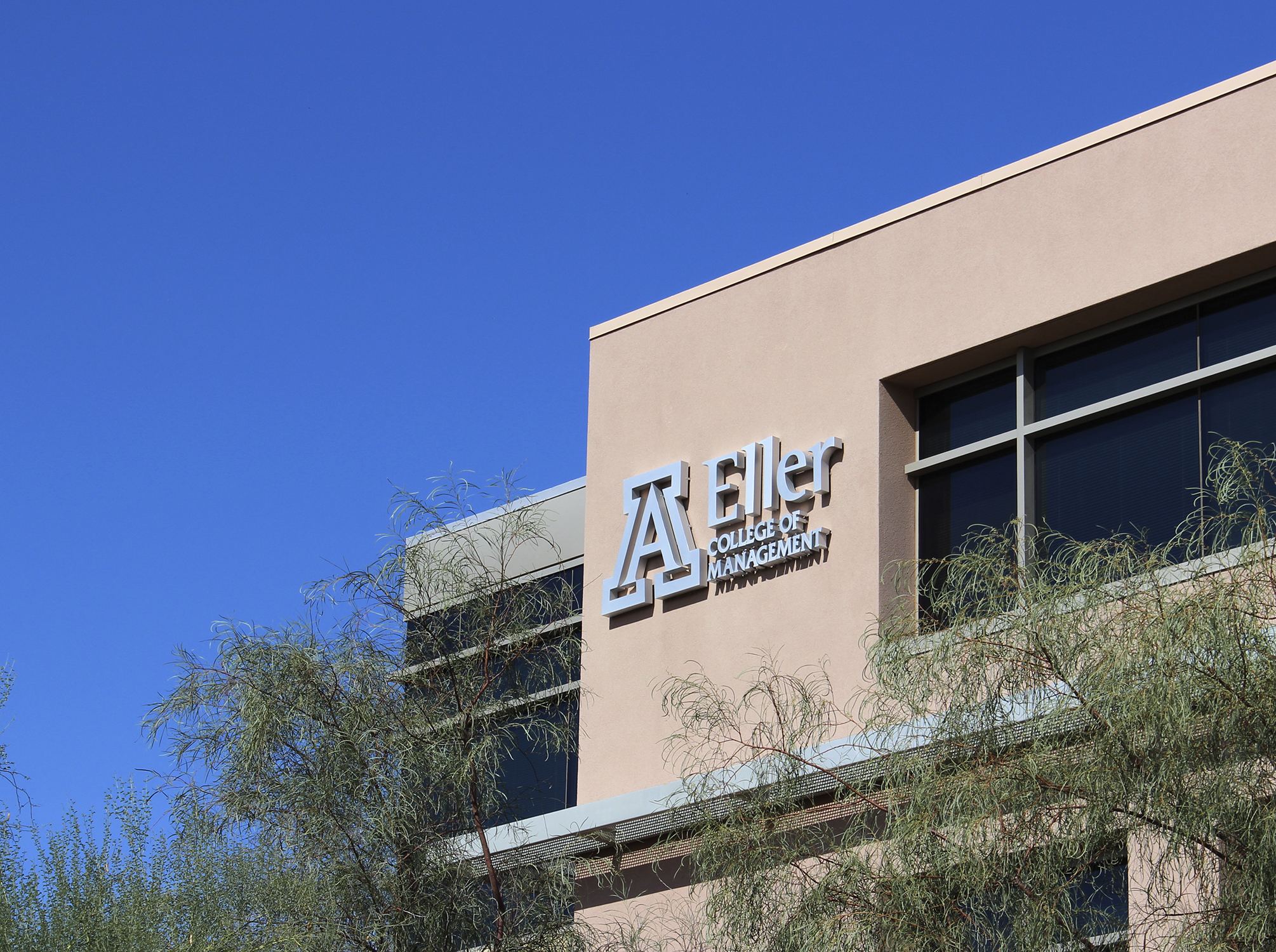 The halo-lit letters and logo are built from brushed aluminum.