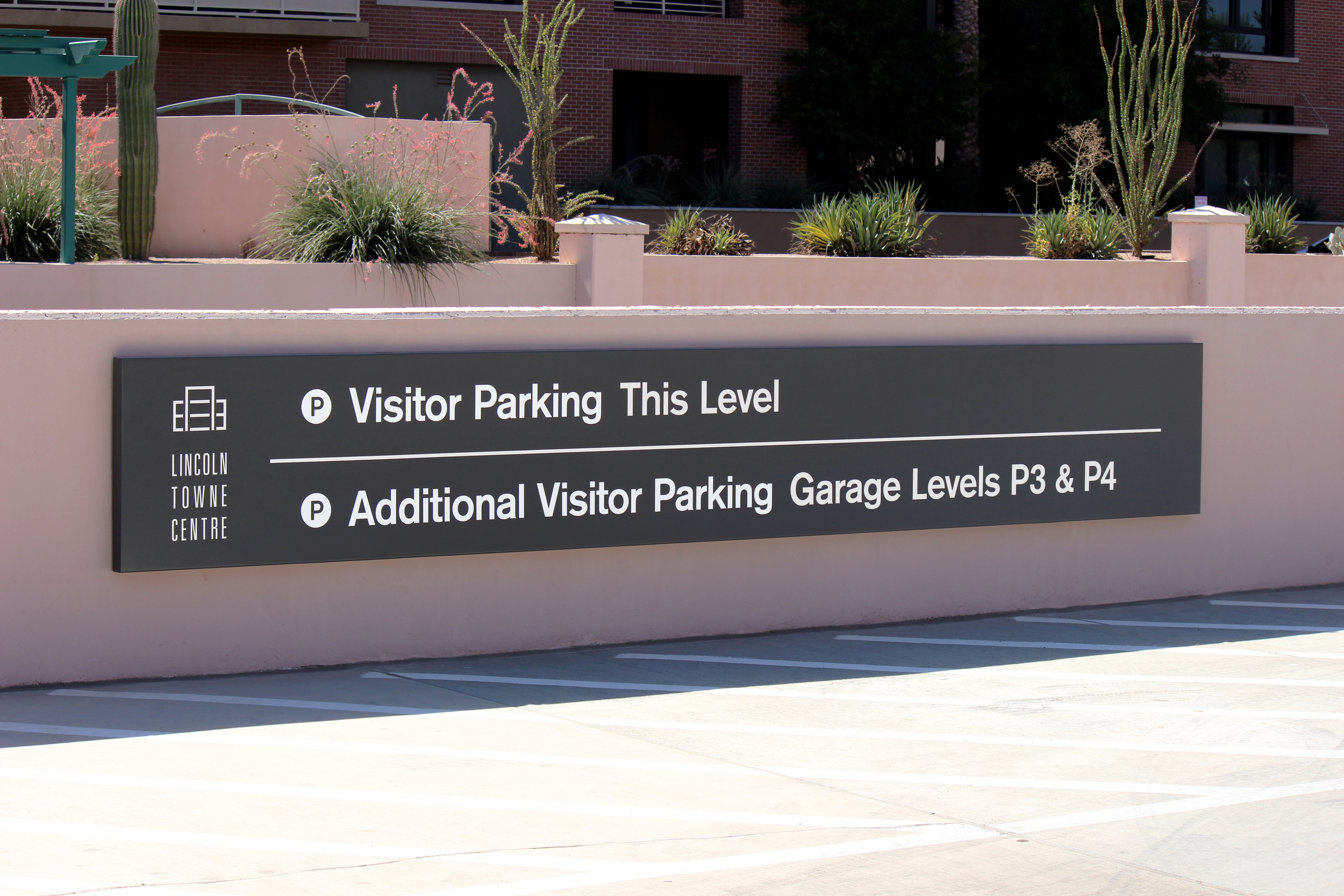 A folded aluminum panel directional sign.