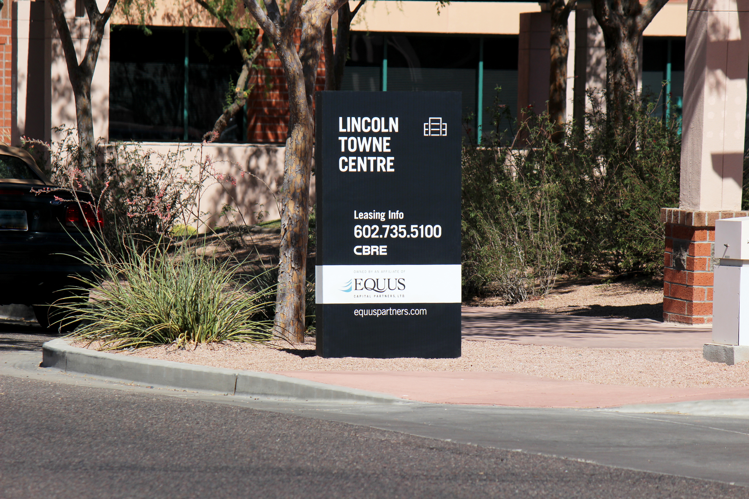 The leasing sign helps promote the project's brand.