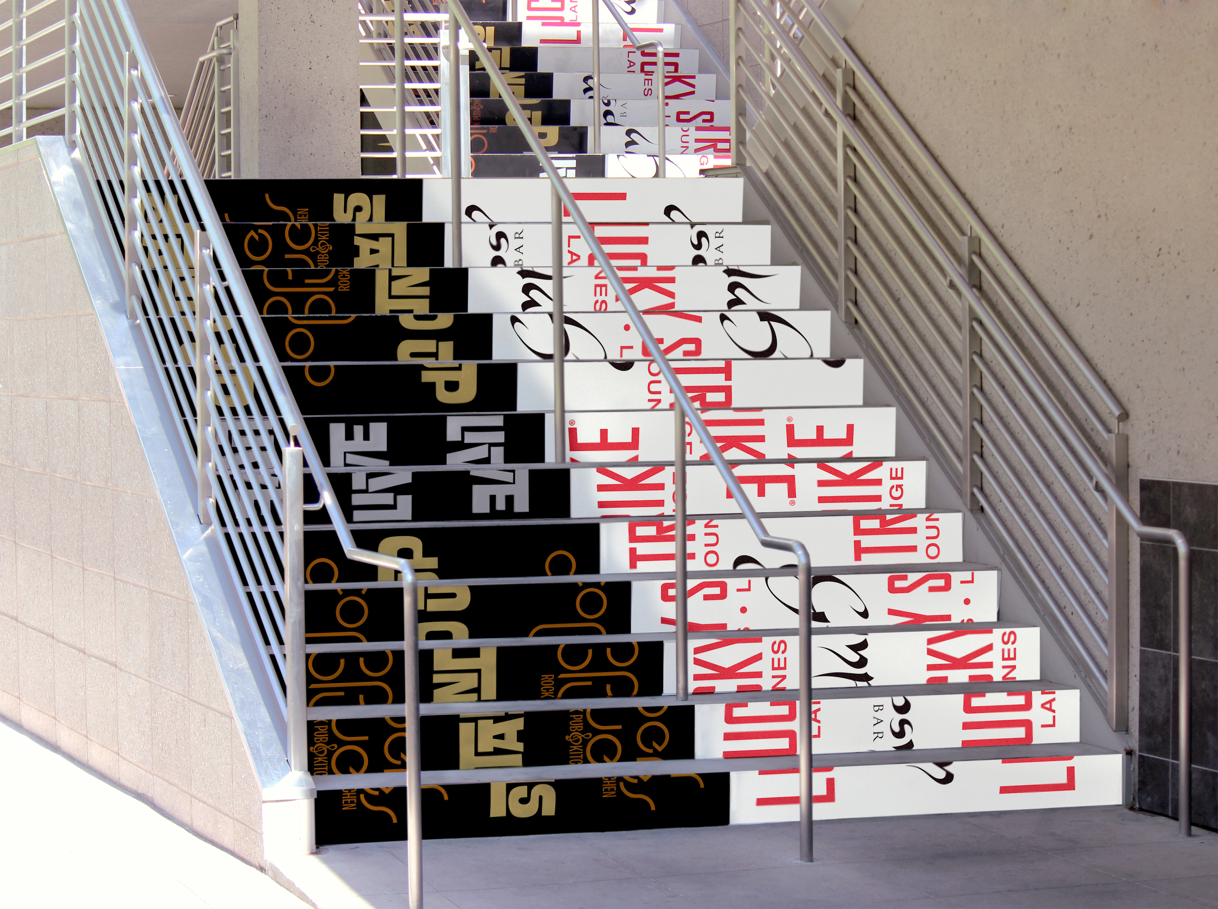 Digitally printed stair graphics welcome patrons to the second floor restaurants and clubs.