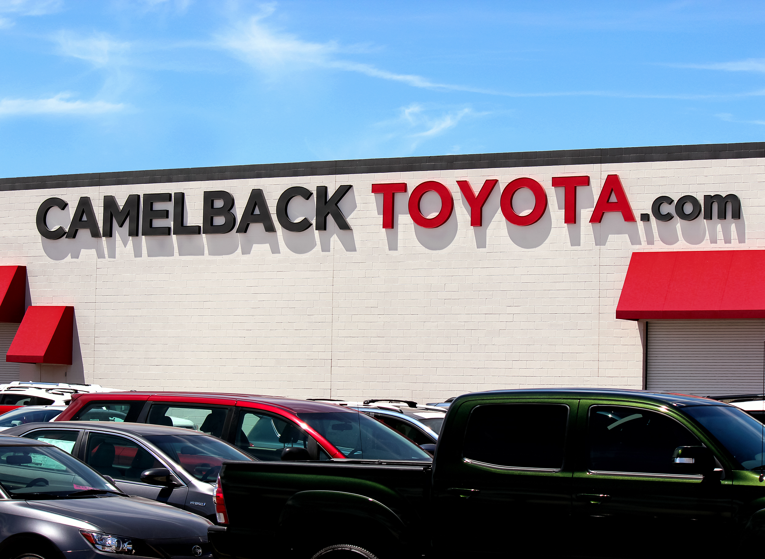 Four-foot tall channel letters with day/night perforated vinyl brand the Camelback Toyota website.