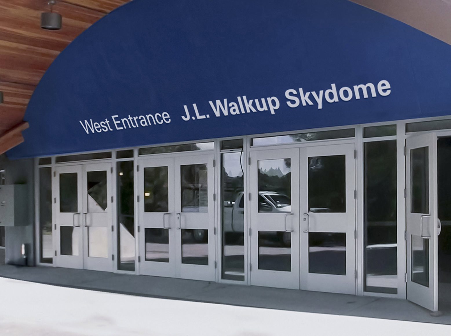 The West Entrance is identified with flat cutout lettering.