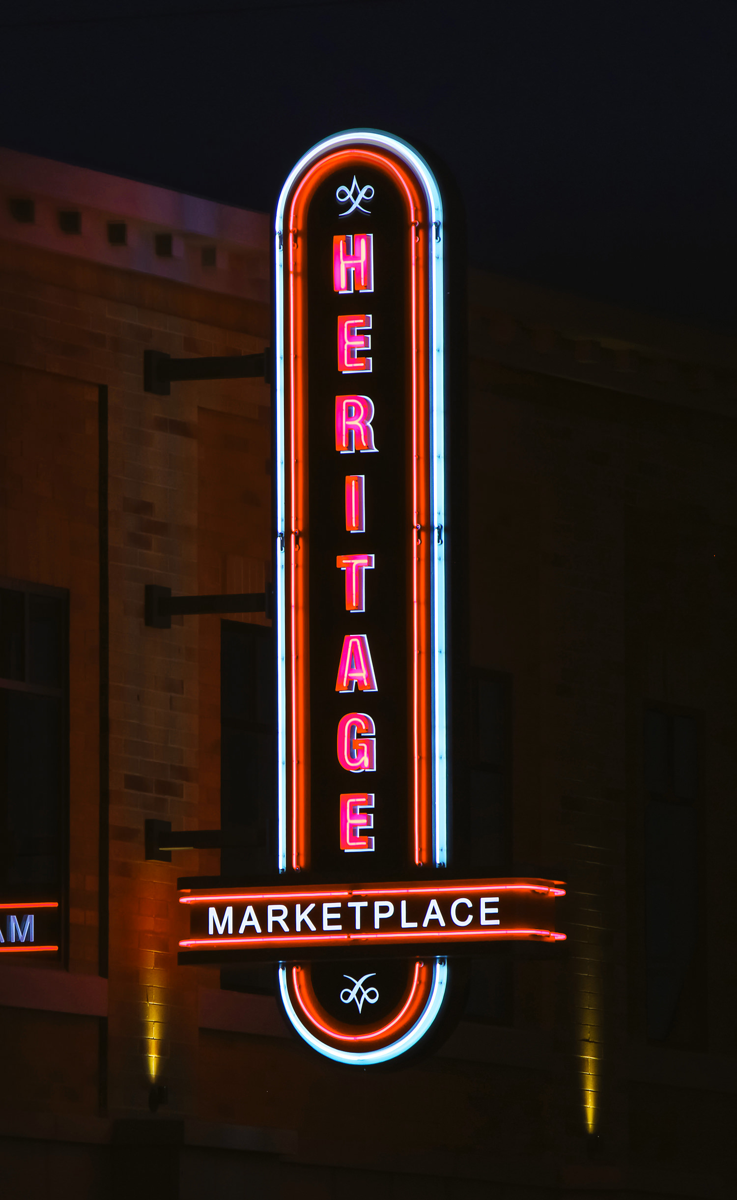 A night view of the blade sign marquee.  The custom neon creates a beautiful glow onto the brick building.
