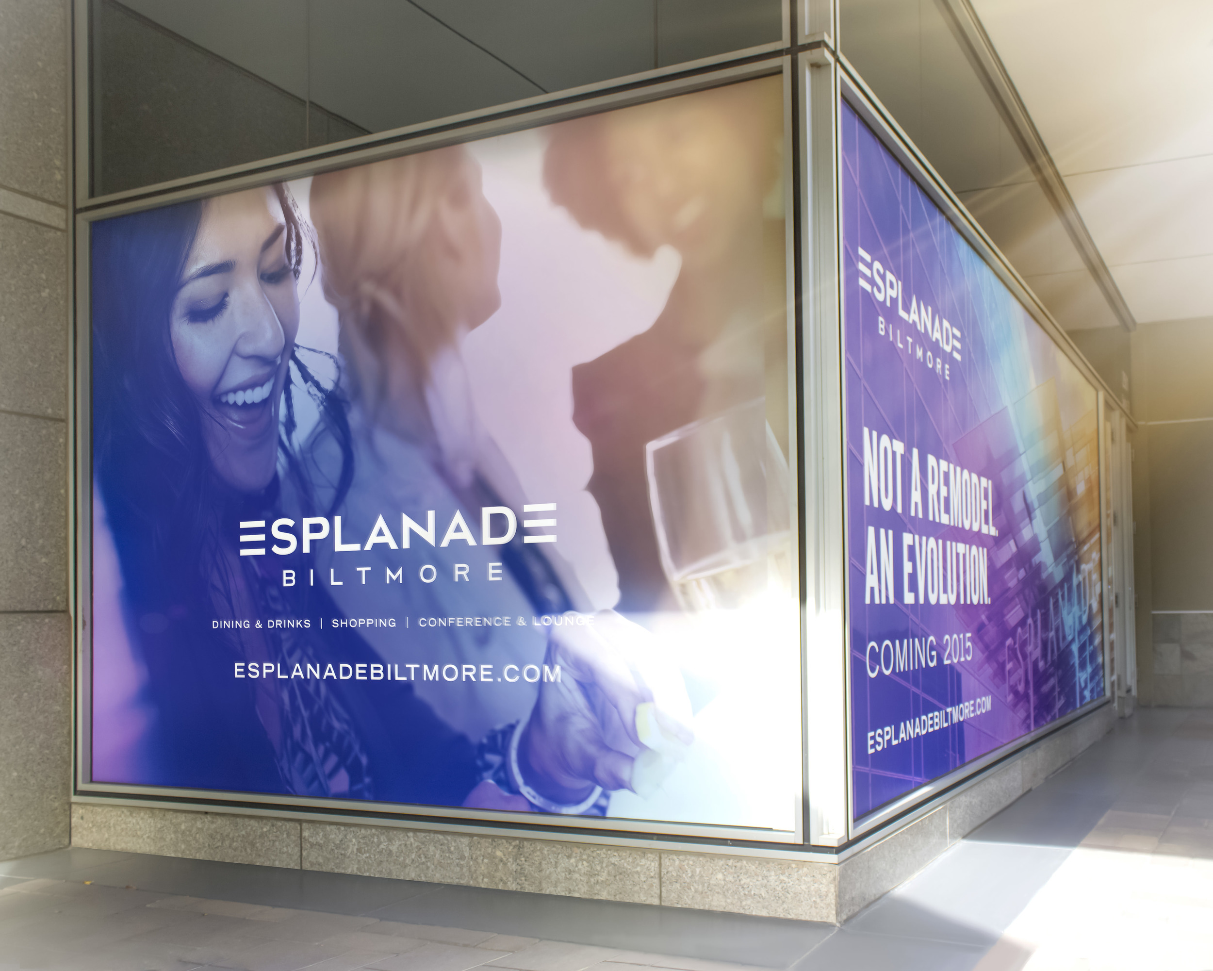 Storefront windows are decorated with the updated Esplanade branding message.