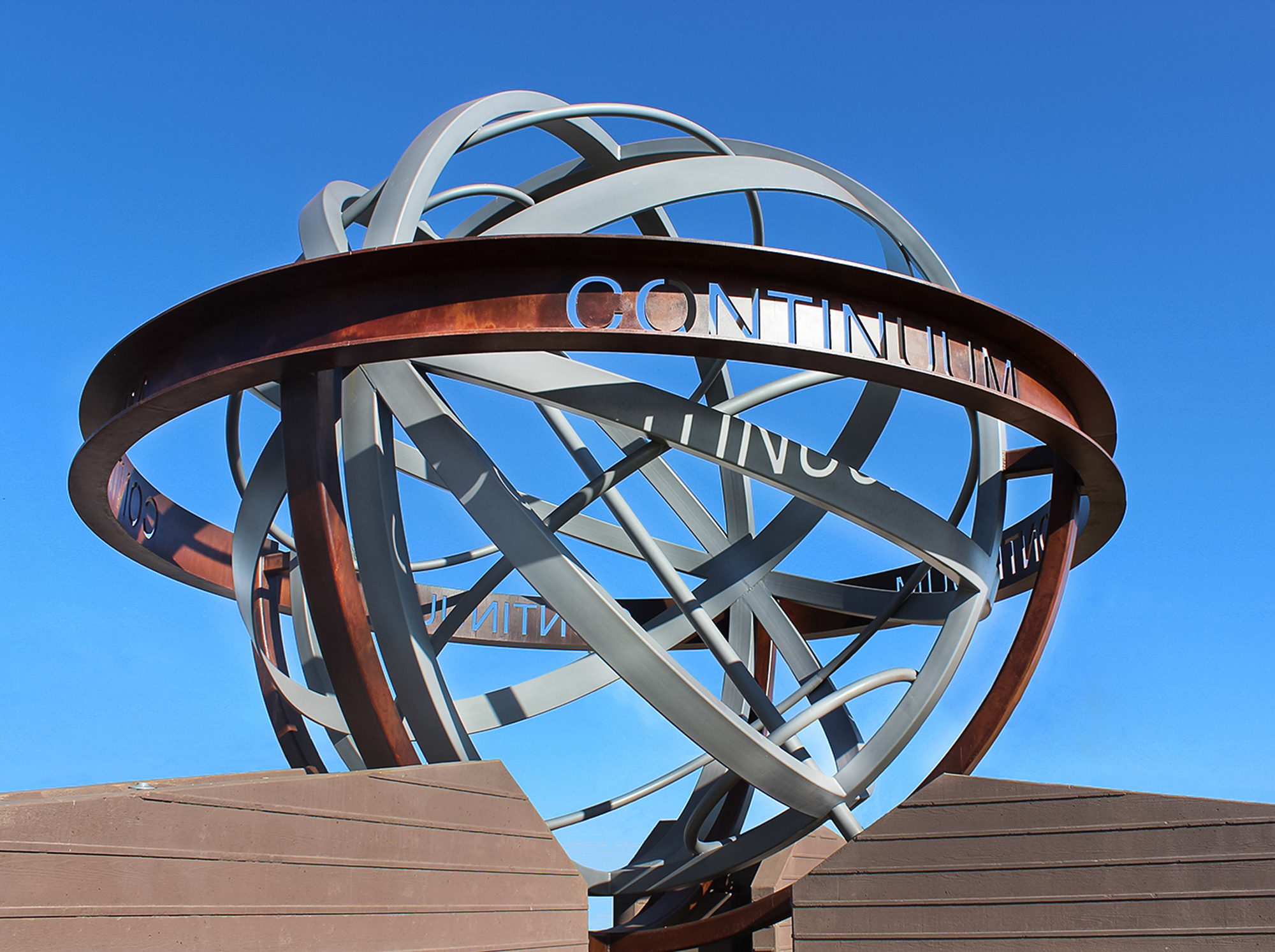 The Continuum globe is the iconic centerpiece for the office park. The 24' radius steel globe is painted with sophisticated finishes to recreate rust and aluminum textures.