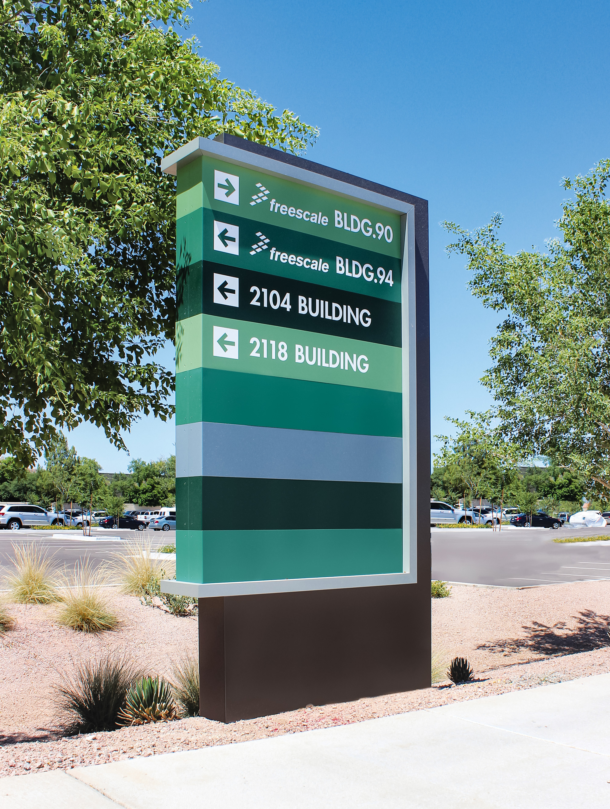 A directional sign for vehicular wayfinding helps visitors of the campus.