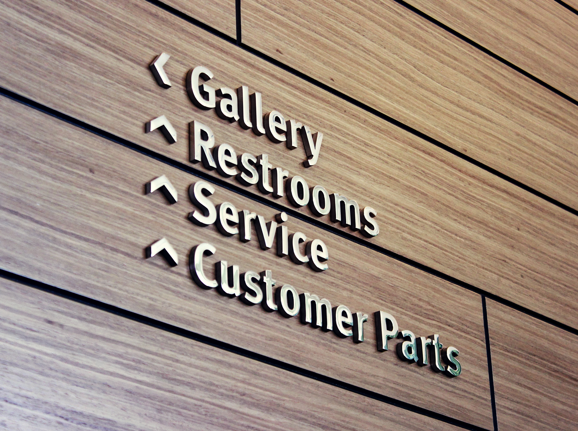 The pin mounted, mirror finish stainless steel letters show customers through the modern dealership.