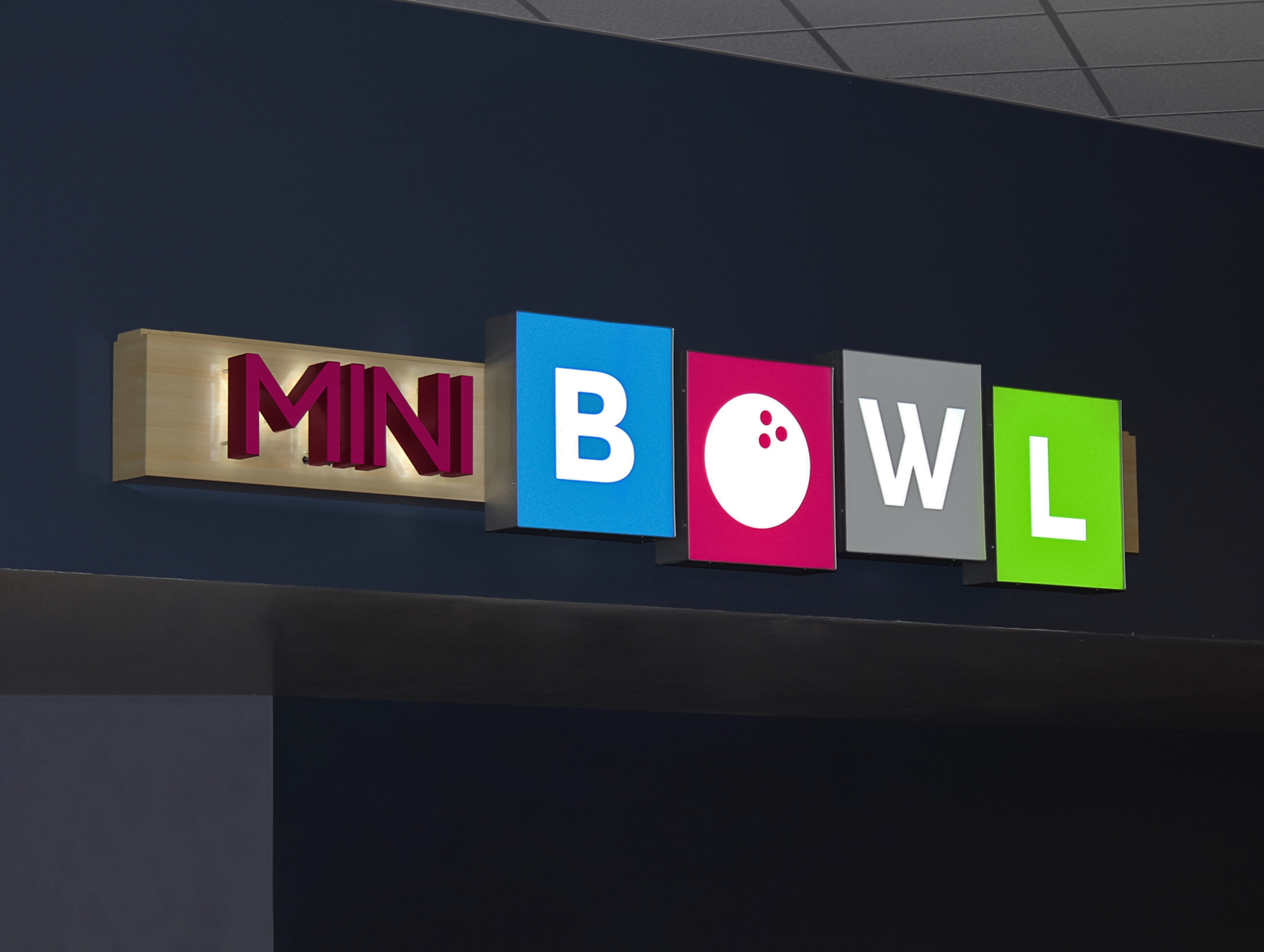 A retro-inspired mini bowl sign with halo lit aluminum letters and face lit acrylic boxes.