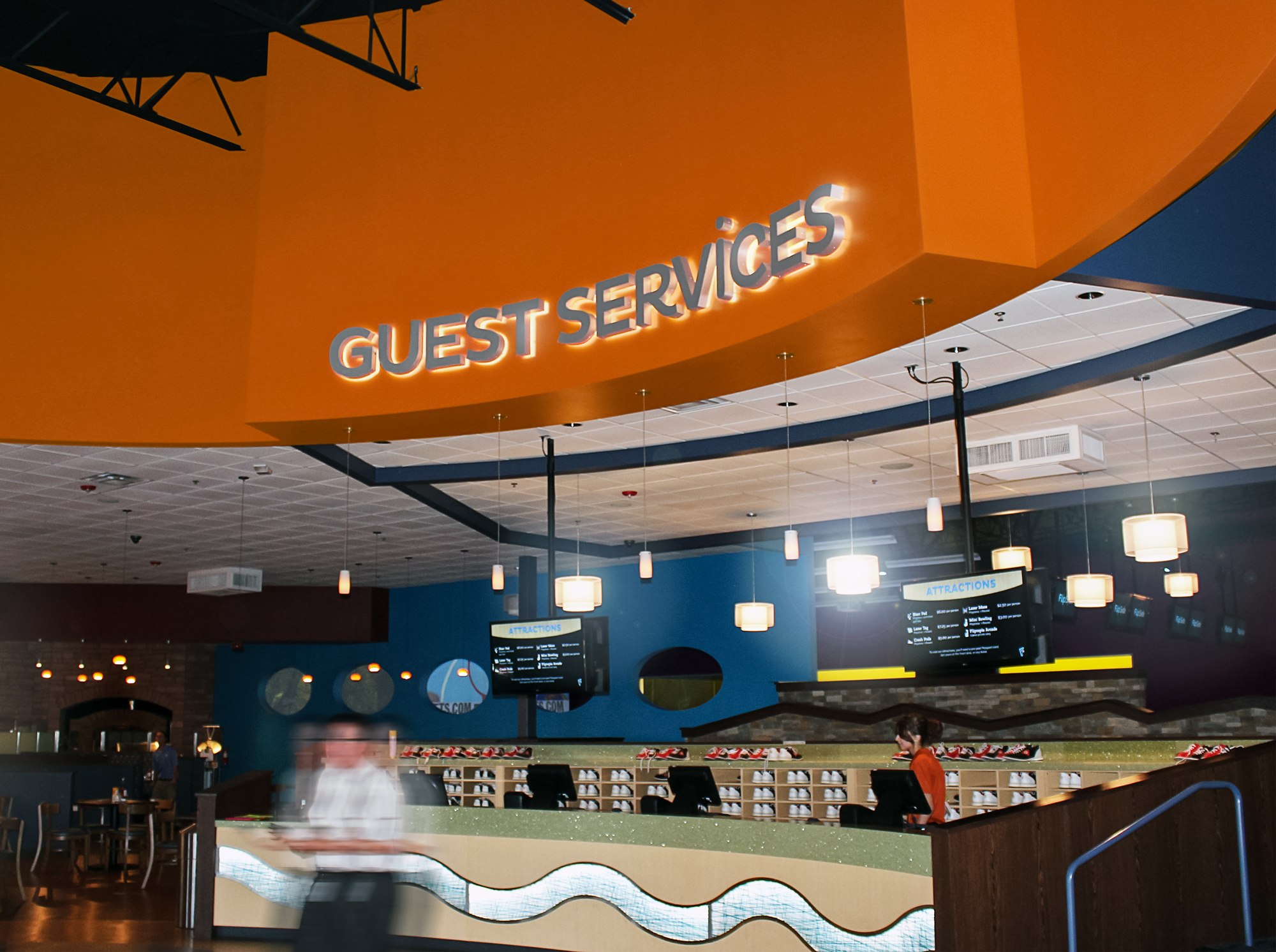 A halo-illuminated Guest Services letterset.