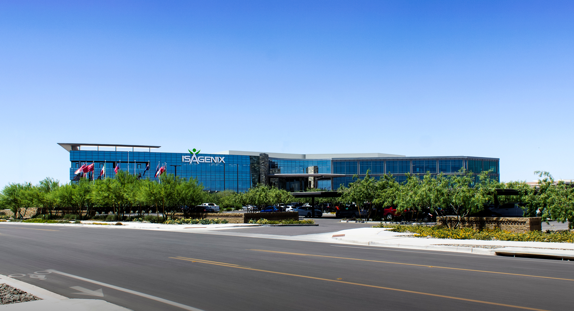 The Isagenix building top sign proudly brands the glass building.