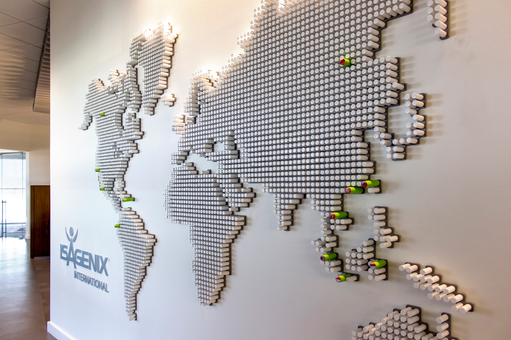 This map is fabricated using custom routed acrylic pegs mounted to a back plate.Each Isagenix office is denoted with an oversized green peg and map.
