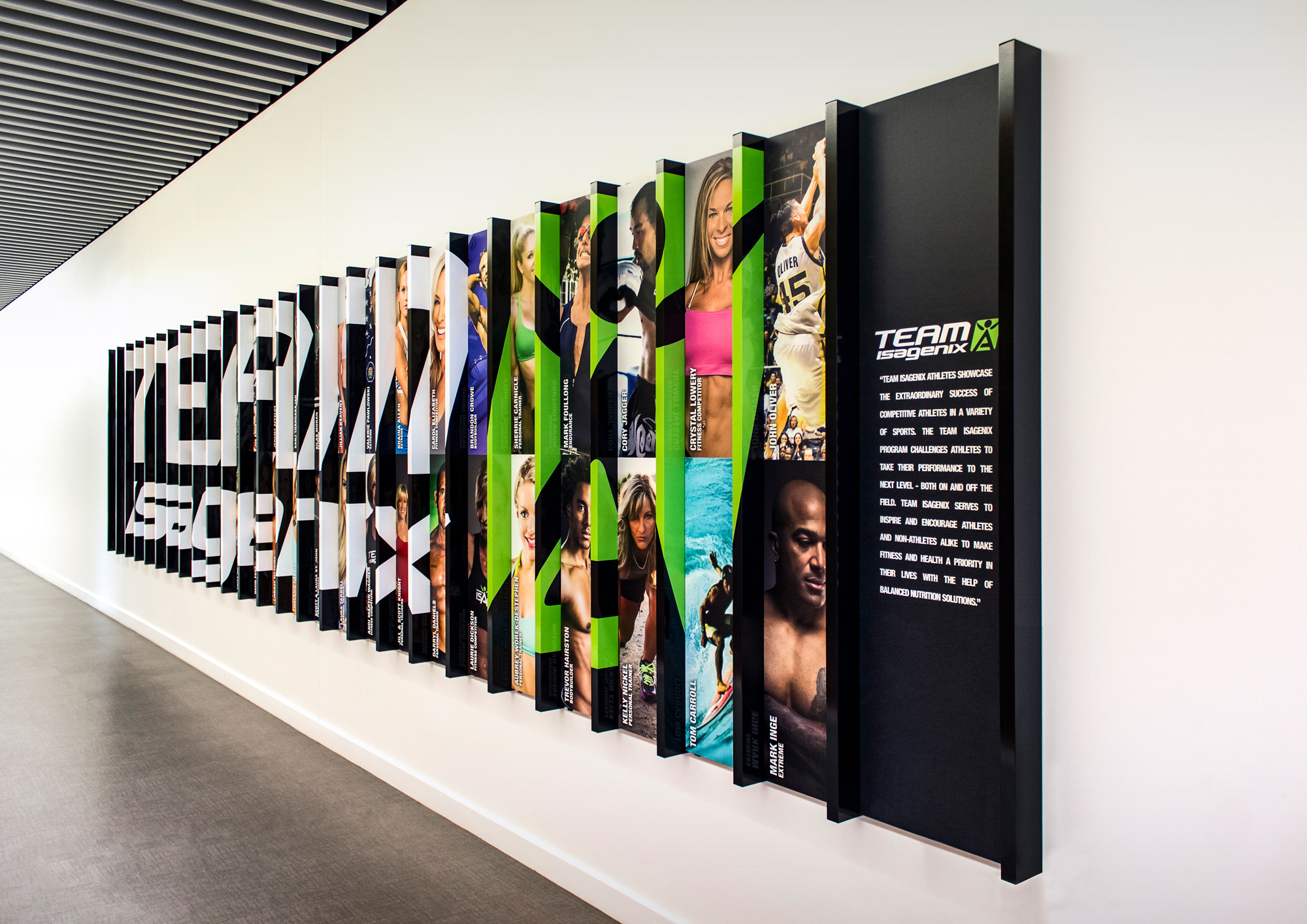 Team Isagenix is displayed down an office corridor.The custom display uses both direct print on Gatorfoam and wrapped aluminum tubing.