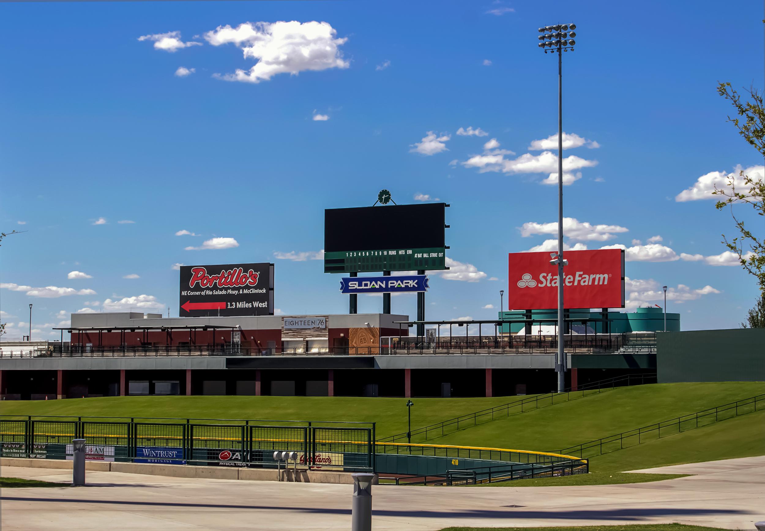 Channel letters reading Sloan Park proudly brands the field's scoreboard.