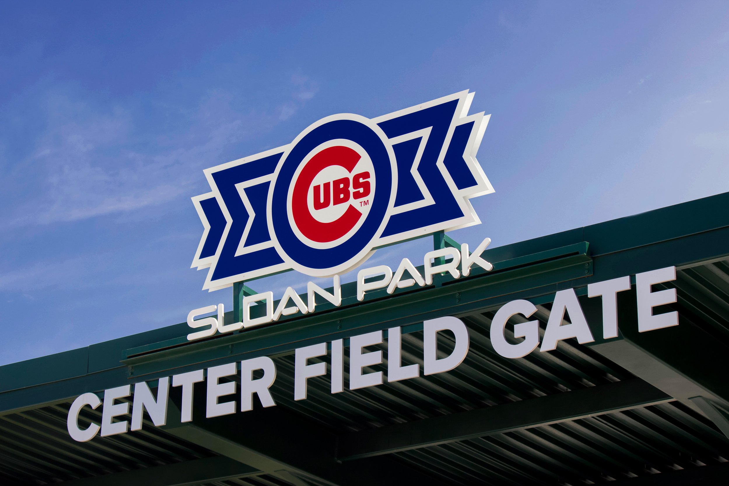 A flat cut out aluminum canopy sign marks the center field gate entrance.
