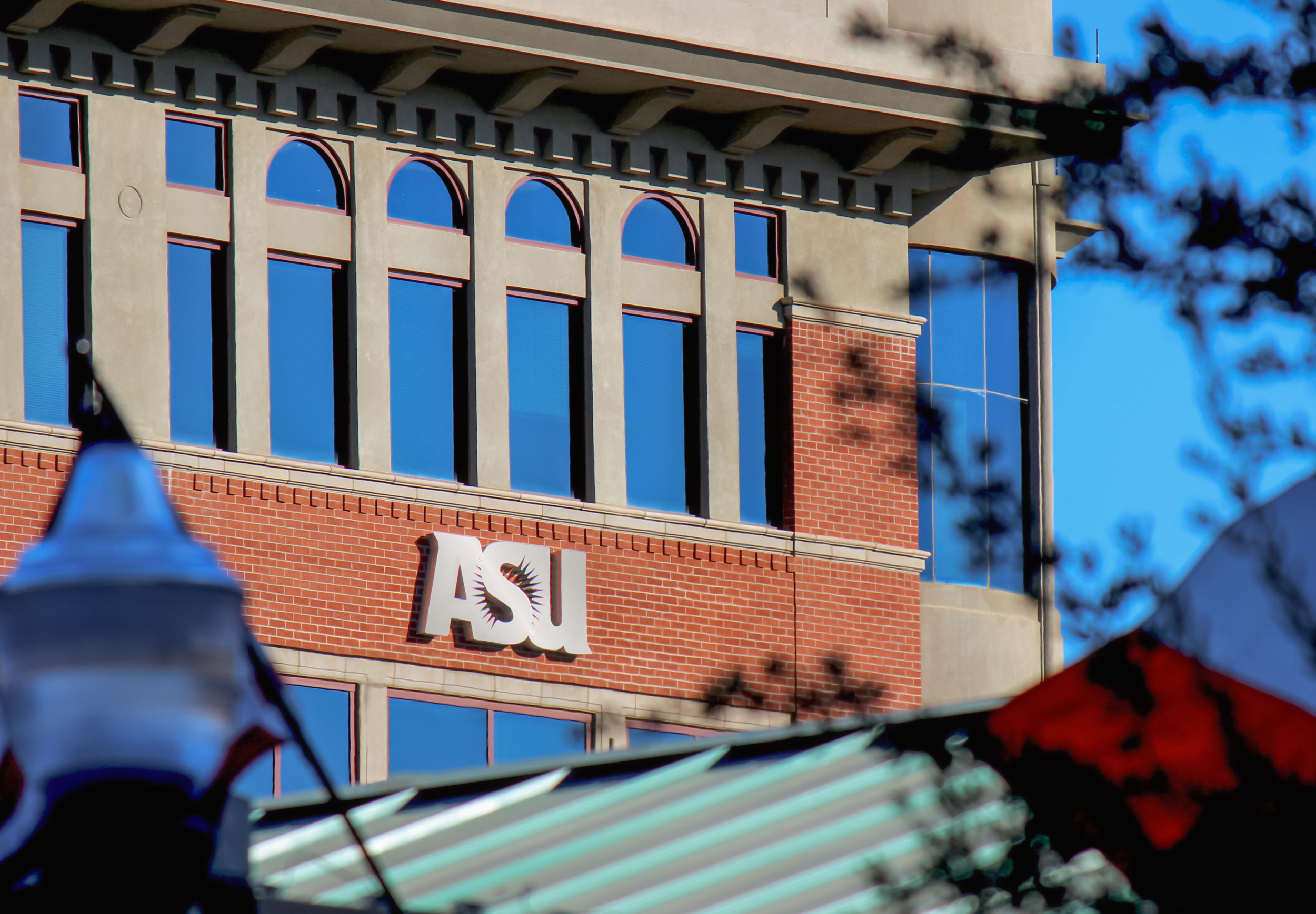 A custom designed ASU logo with perforated returns and LED illumination.