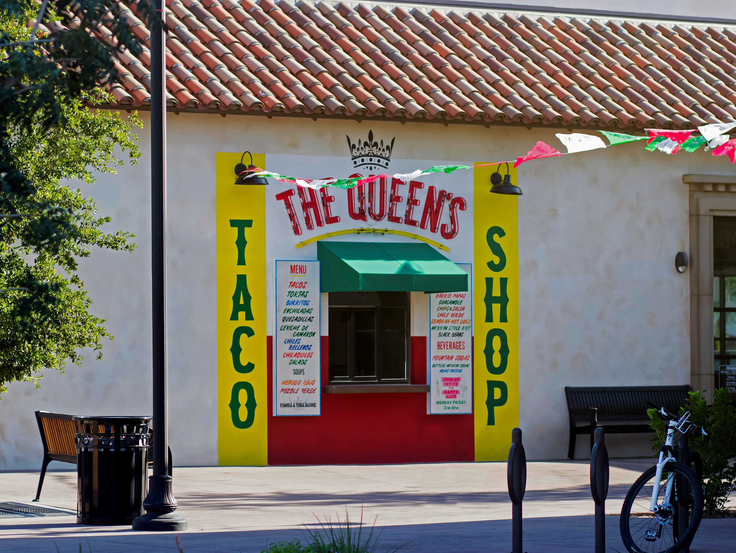 The Queen's Taco Shop painted wall mural is illuminated using downlights and skeleton neon.