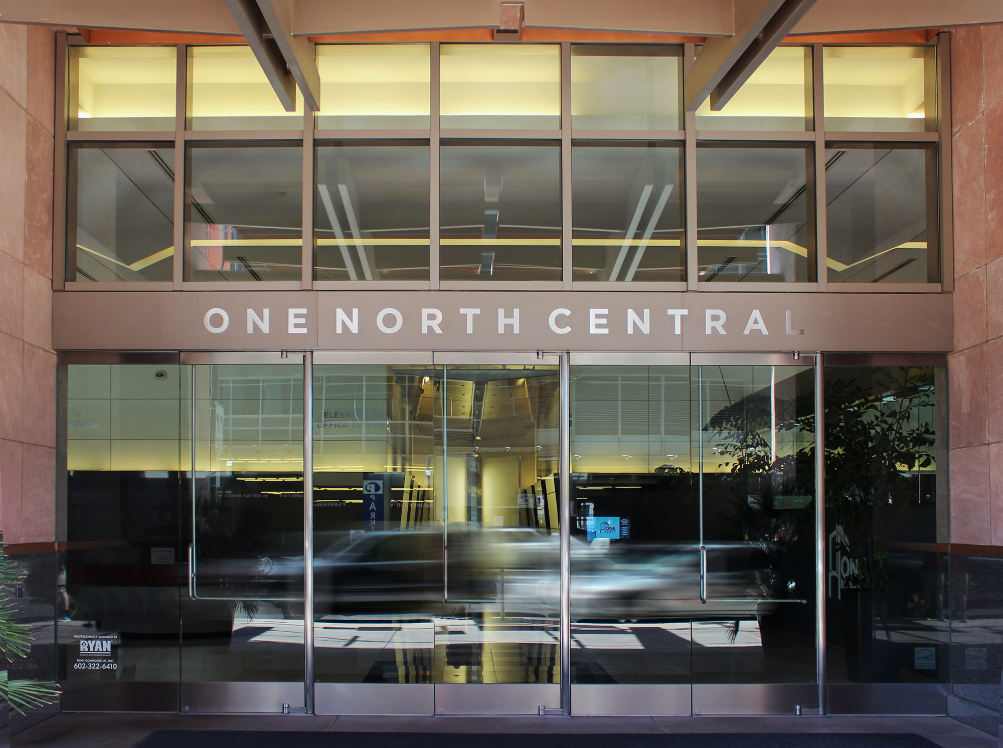 The main entrance is marked with reverse pan brushed aluminum letters.