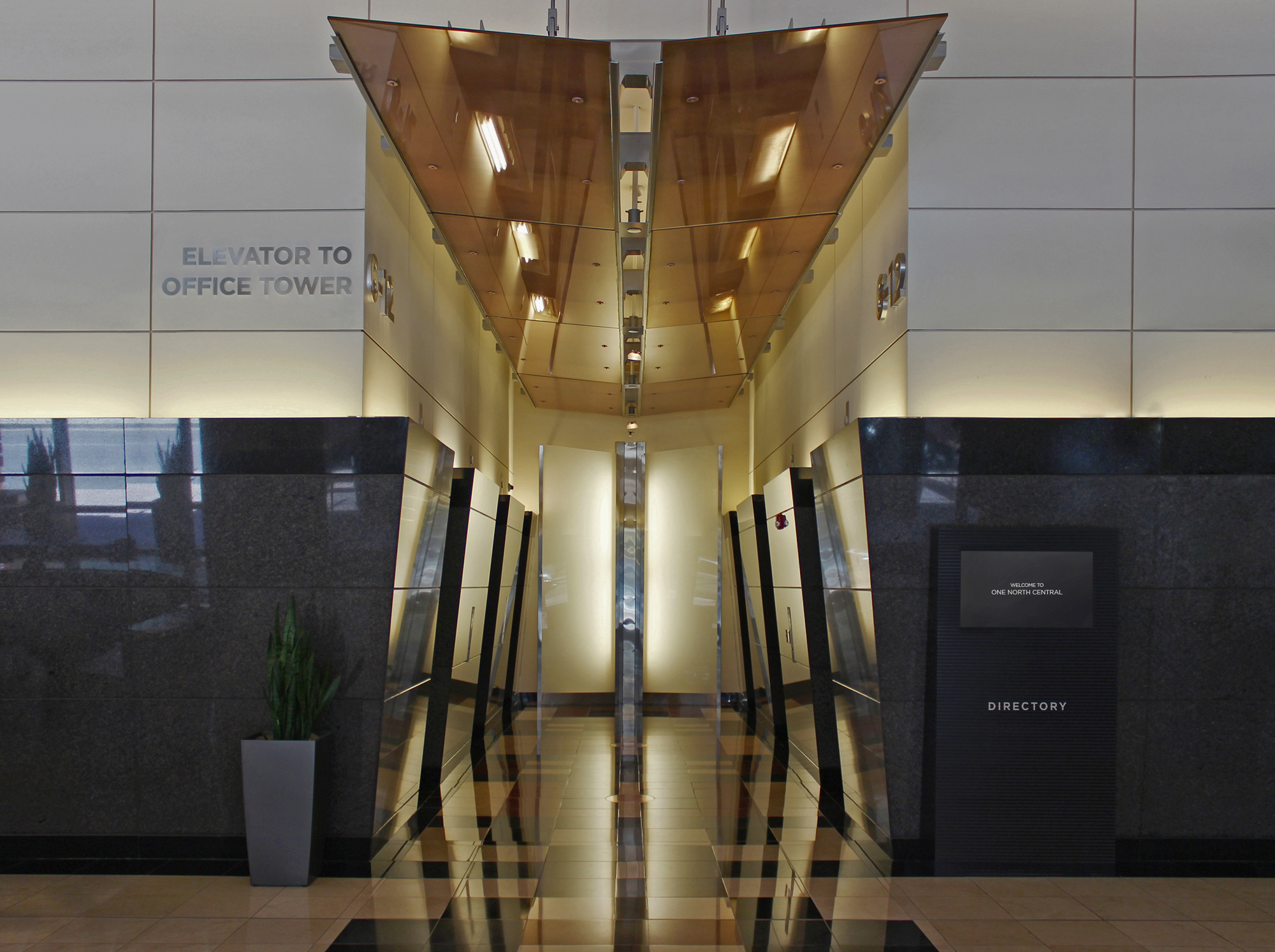 The lobby's visitors are directed using custom fabricated wayfinding elements.