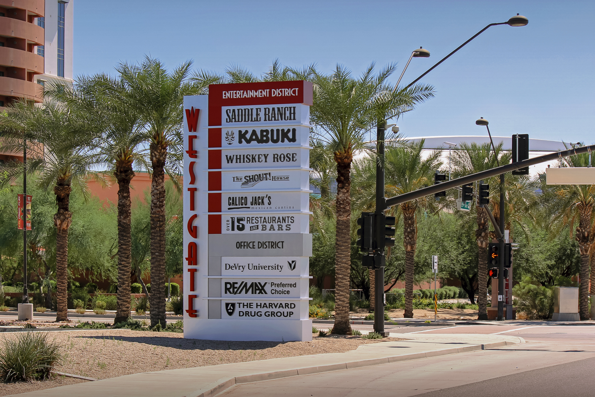 A third ground sign identifies the entrance for various tenants.Vertically oriented reverse pan channel lettering brands the development.