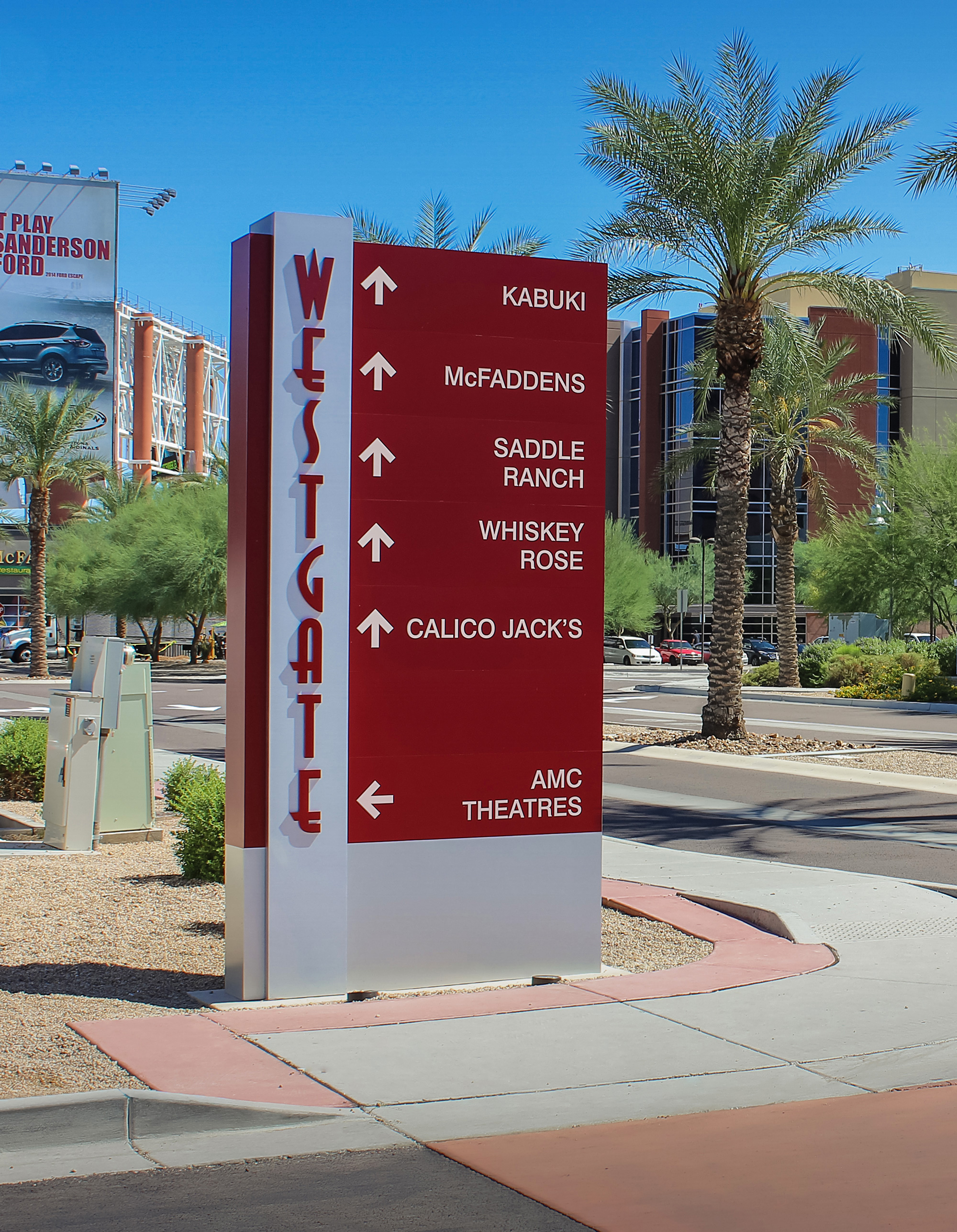 Non-illuminated vehicular wayfinding signs are constructed using aluminum with flat cut out lettering and reflective vinyl text.