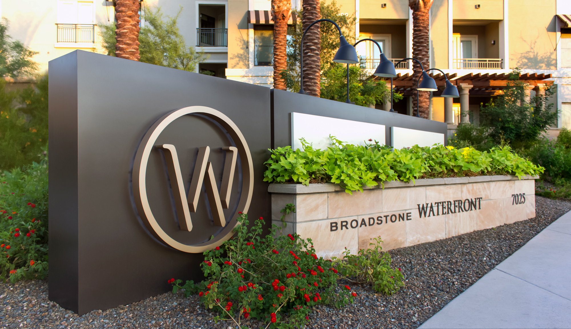 The project's multi-tenant ground sign.This monument sign incorporates both direct and indirect lighting elements.