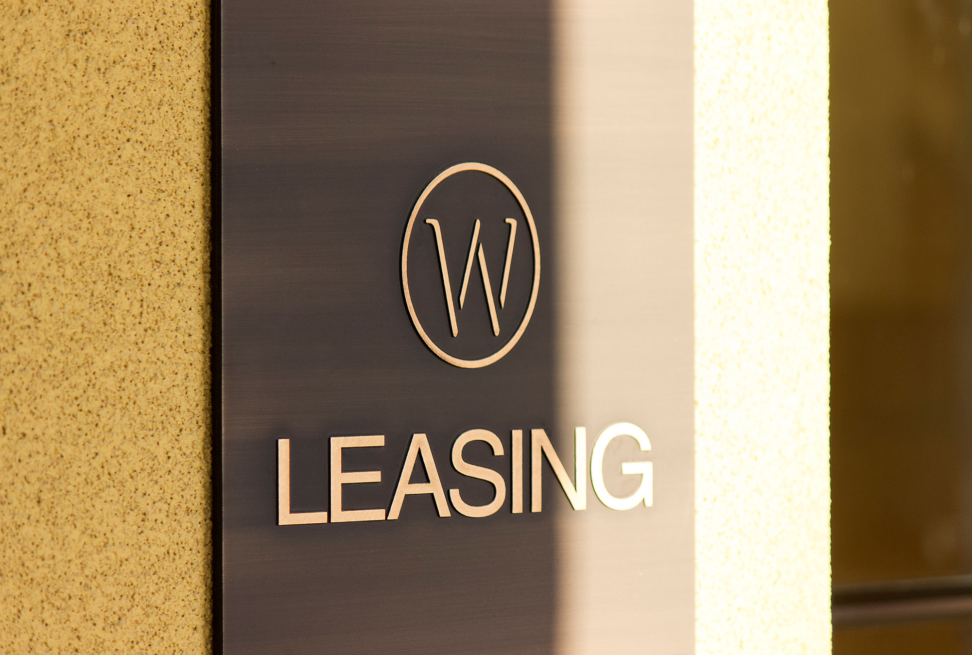 An up close view of the custom etched bronze plaque with raised lettering.