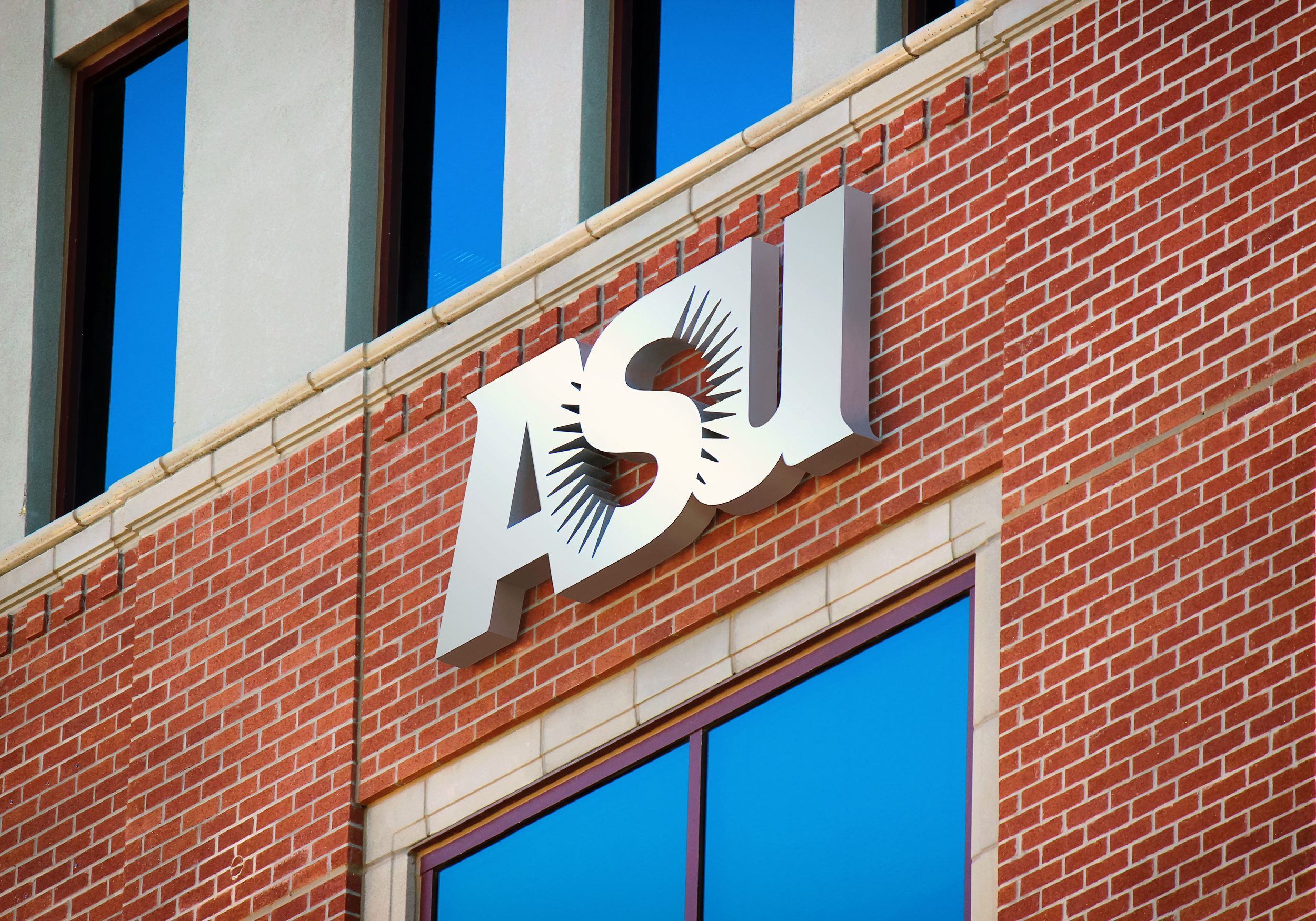 This closeup photo shows the perforated return detail as well as the intricate ASU sunburst.