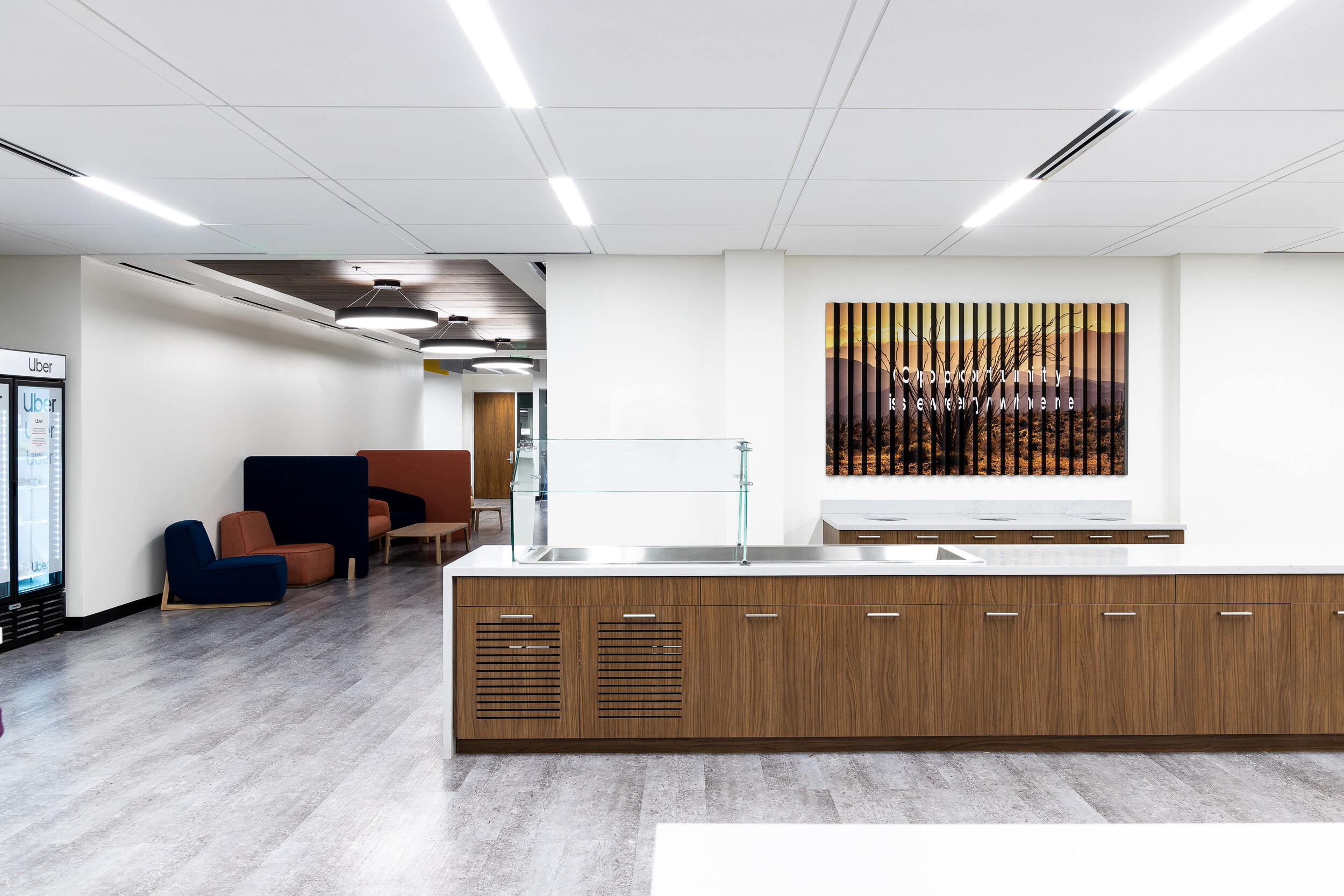 A stainless steel reception display brands the lobby. The reverse pan channel and flat cut out lettering is mounted to a custom perforated metal mesh material.