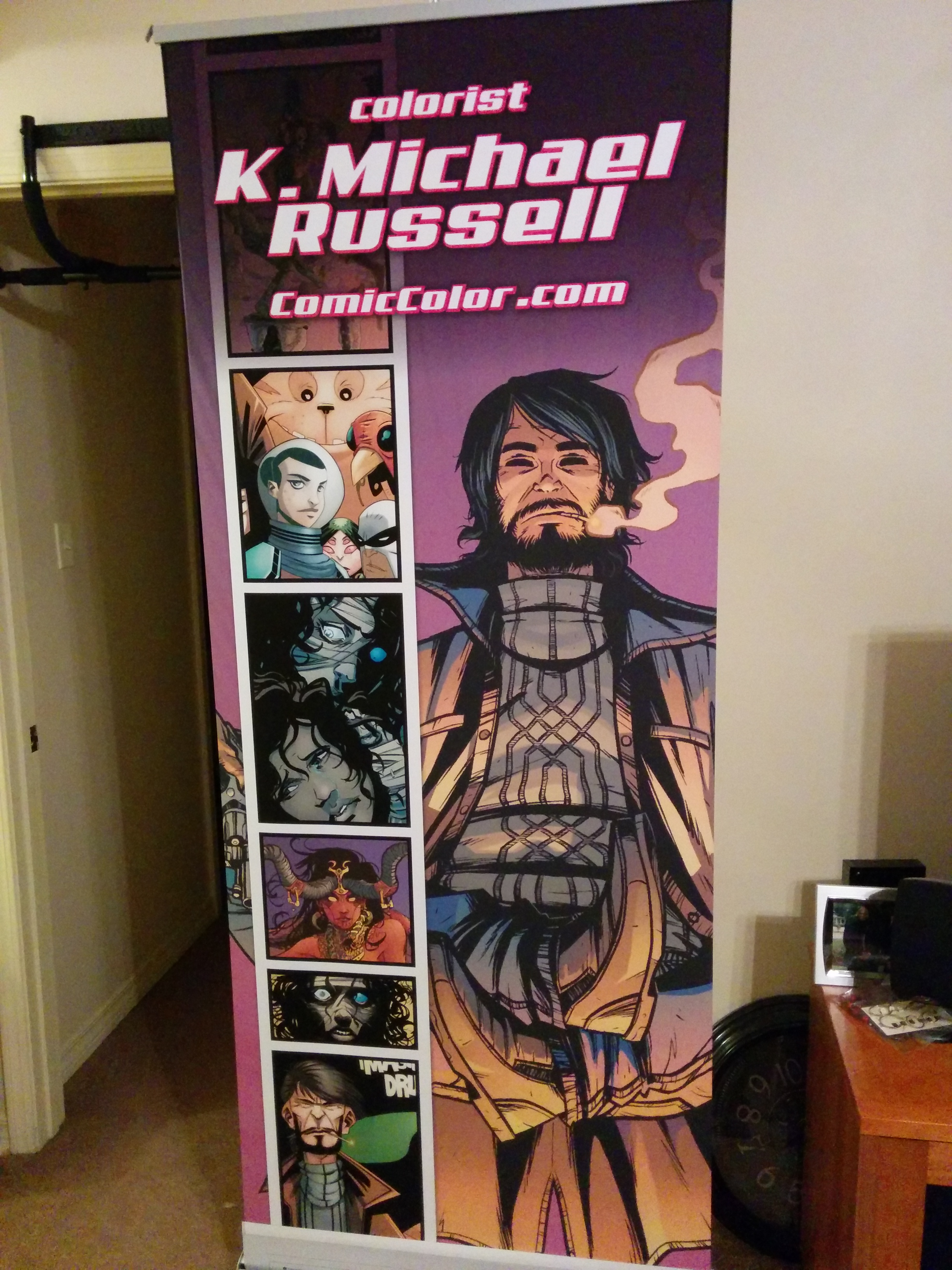 The new convention banner just arrived, and it looks fantastic. Thanks to Mr. Steve Becker for the awesome design. The featured image on the right is by Jonathan Brandon Sawyer. The panels going down the left side include line-art from Valentin Ramon Menendez, Francesco Prenzy Chiappara, and Stephen Green. So thanks to all those guys.
