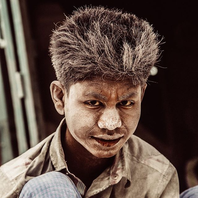 A shot from my first trip to Mandalay. A Burmese boy smiled momentarily while grinding away at a marble statue he was finishing. The boys in this district live and work in extreme conditions  often inhaling dust and chemicals while producing Buddhist statues paid for by the rich. They make about a dollar a day. That doesn't seem very Buddhist to me for some reason. #mandalay #50mm