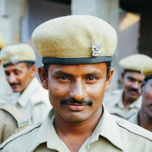 Hangin' with the police in Hampi. One of many portraits I captured when I somehow found myself walking through a police brigade training session. #onlyinindia #police #beretstyle #smirk #50mm