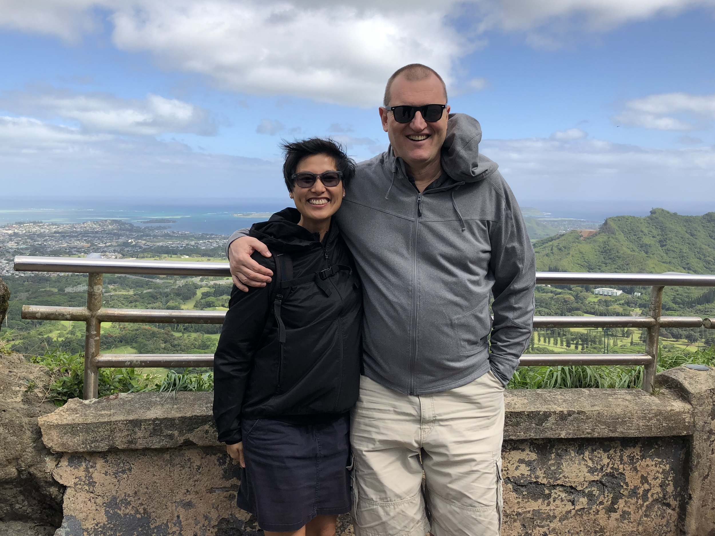Braving the strong winds to check out the beautiful views from the Nu'uanu Pali Lookout on Oahu.