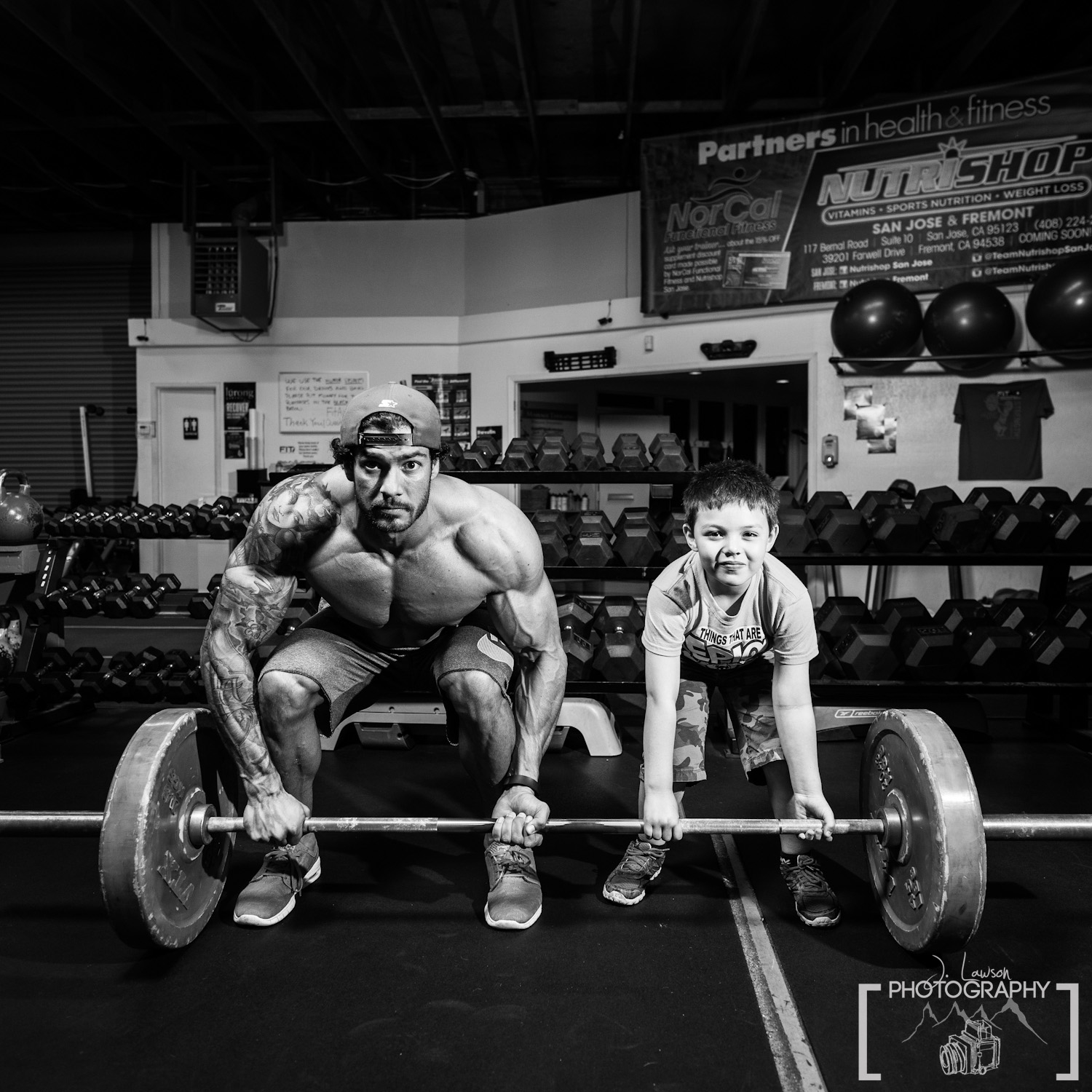 Teaching bodybuilding to a young apprentice