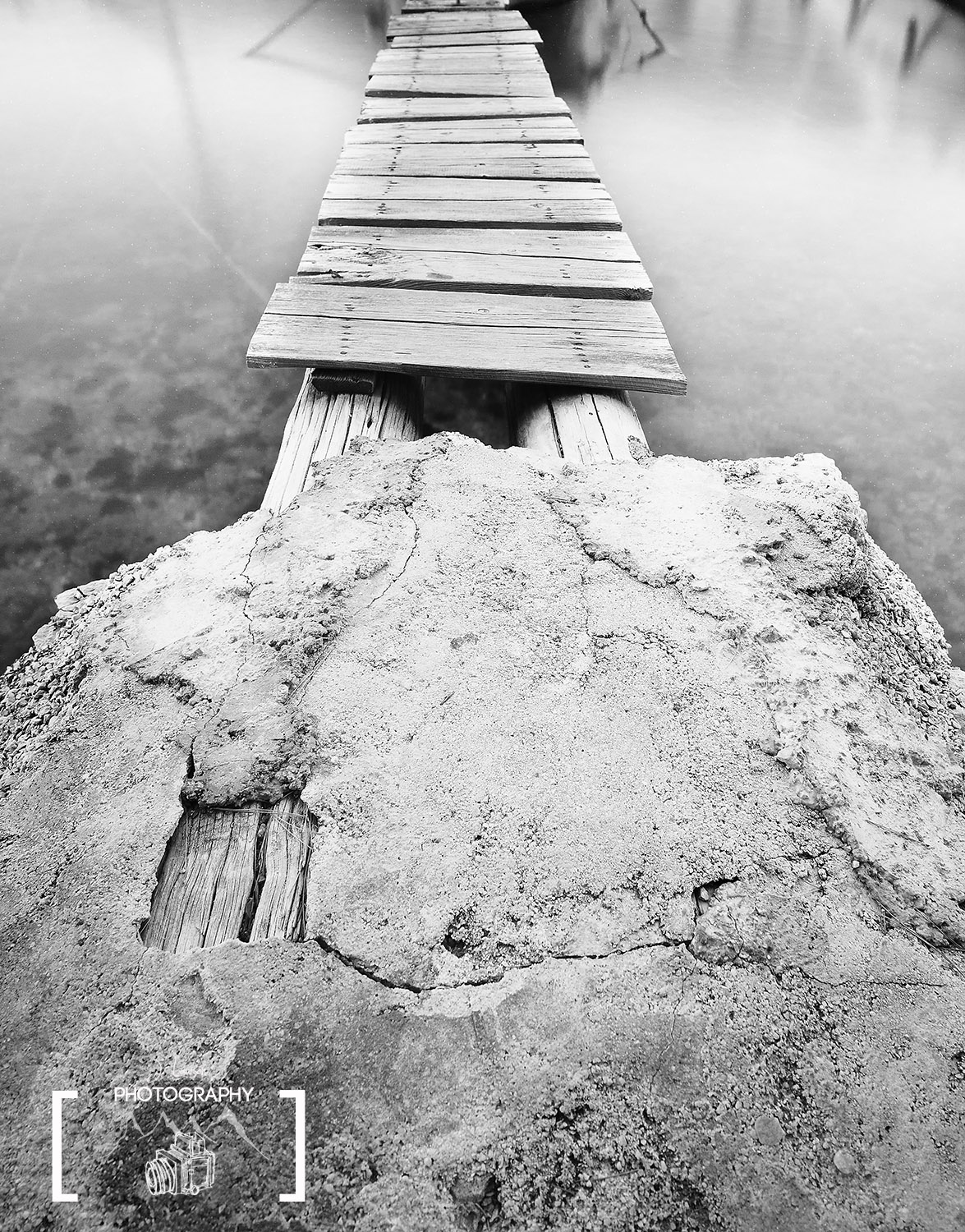 Focusing on the foreground and using long exposure gives an old pier a new look. Photograph by Jared Lawson Photography.
