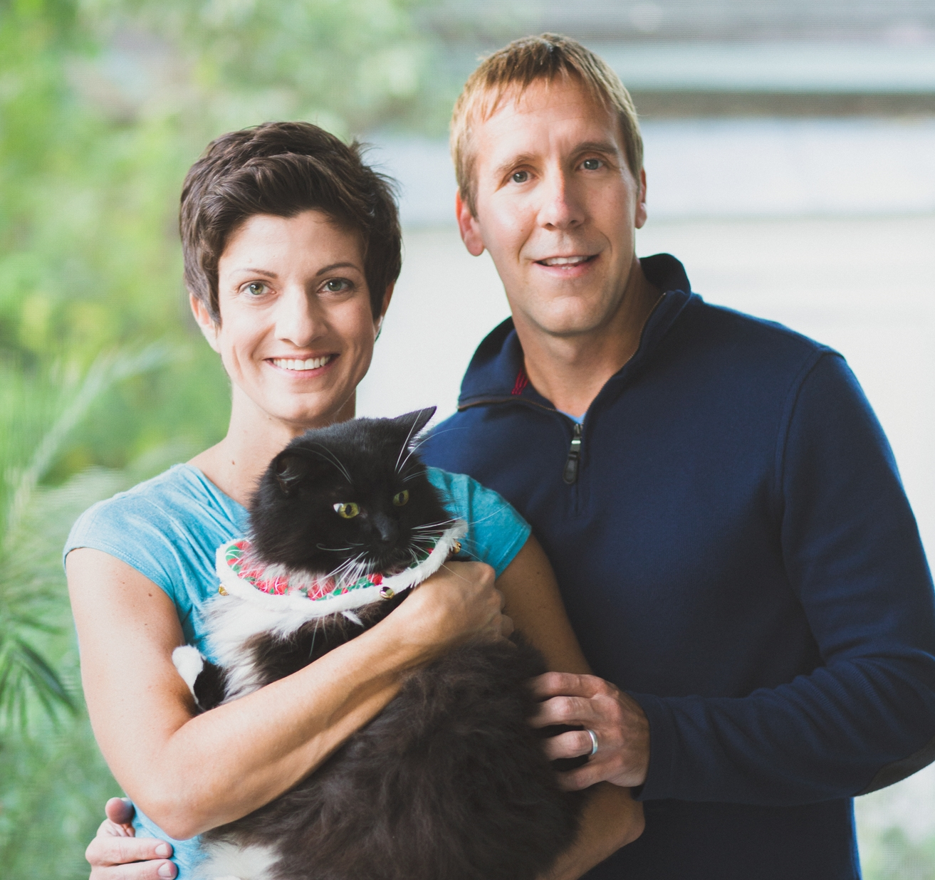 Amy and her husband, Paul Hansen, and Fuzzy, who is keeping a sharp eye on the other two cats.