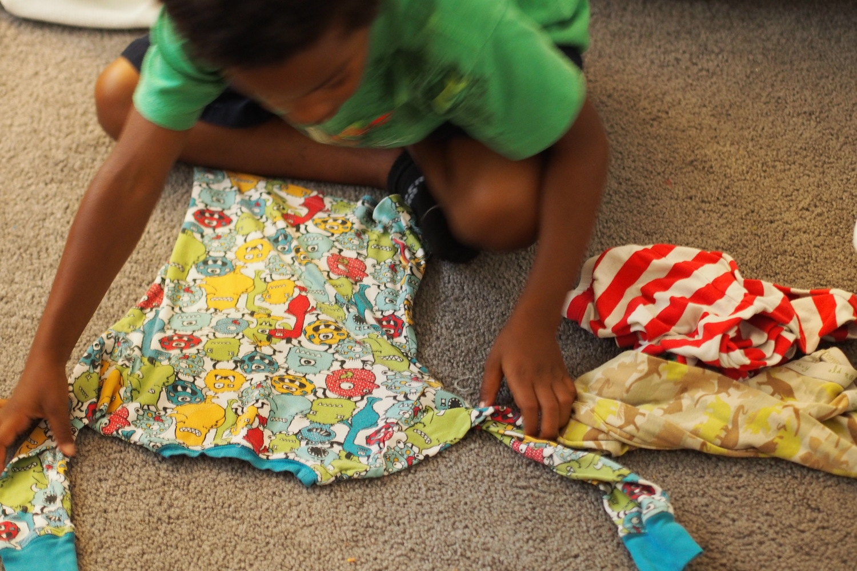 child folds clothes